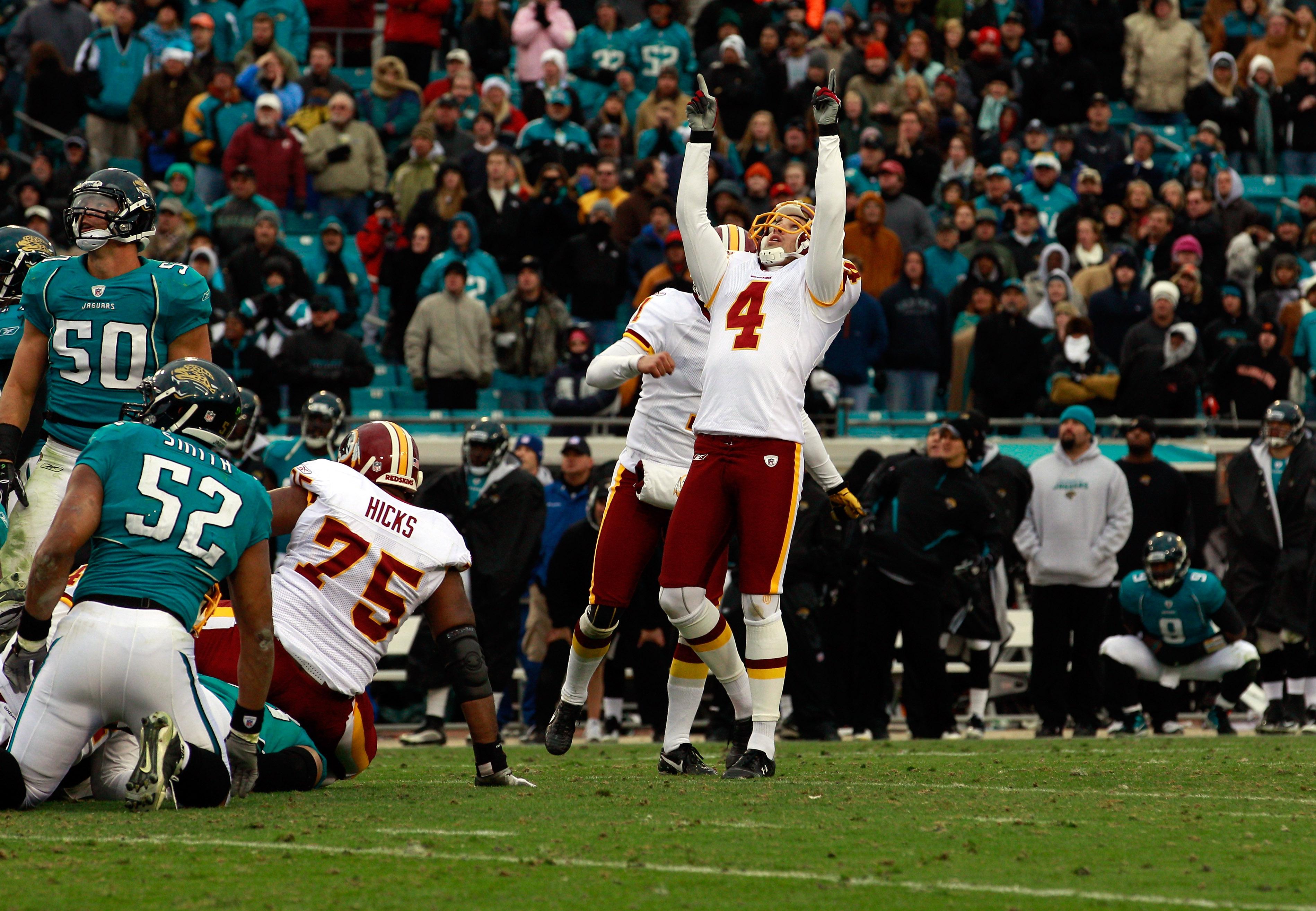 JACKSONVILLE, FL - DECEMBER 26:  Kicker Graham Gano #4 of the Washington Redskins celebrates after kicking the winning field goal in overtime during the game against the Jacksonville Jaguars at EverBank Field on December 26, 2010 in Jacksonville, Florida.