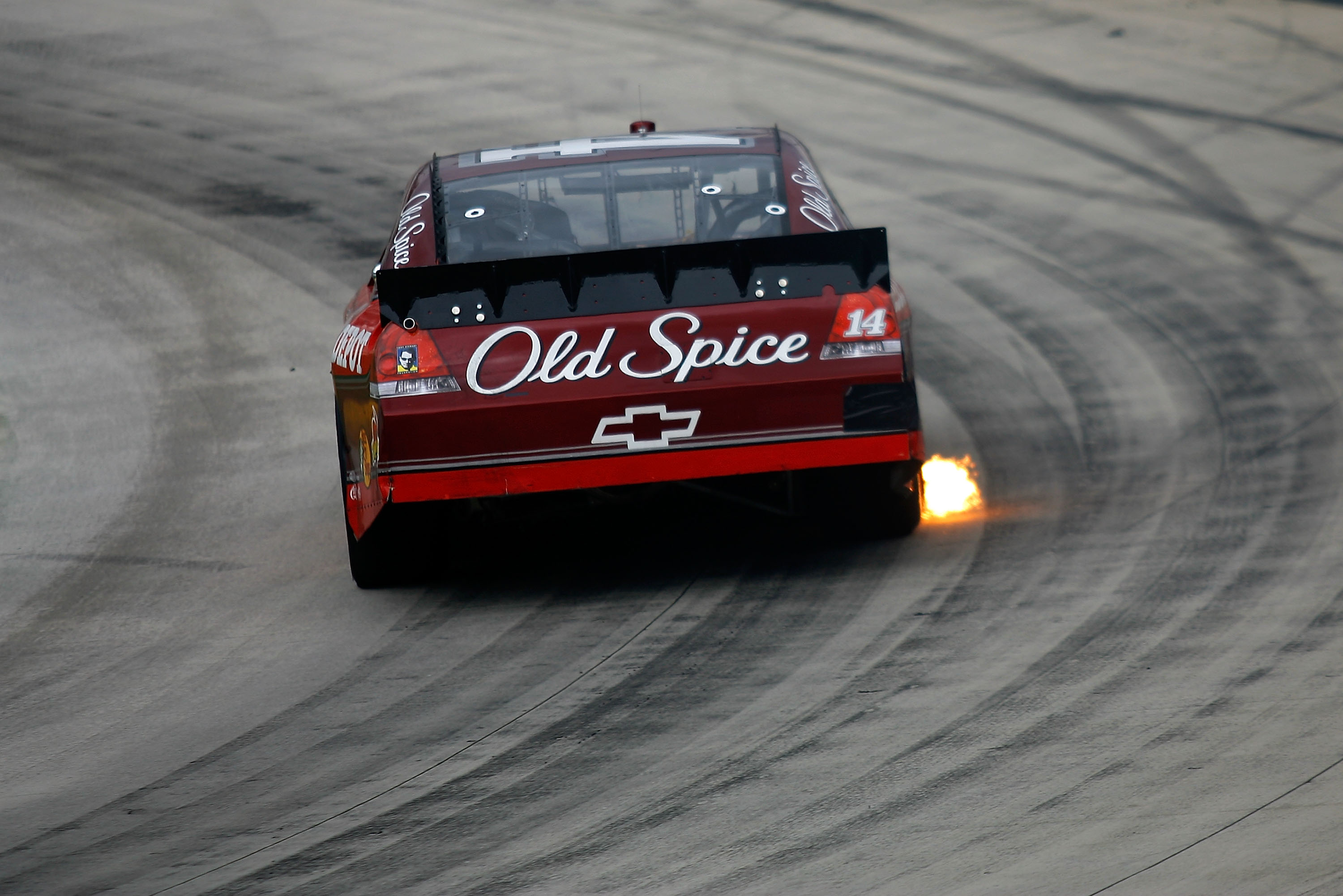 MARTINSVILLE, VA - MARCH 29:  Tony Stewart, driver of the #14 Old Spice/Office Depot Chevrolet races during the NASCAR Sprint Cup Series Goody's Fast Pain Relief 500 at Martinsville Speedway on March 29, 2010 in Martinsville, Virginia.  (Photo by Jason Sm
