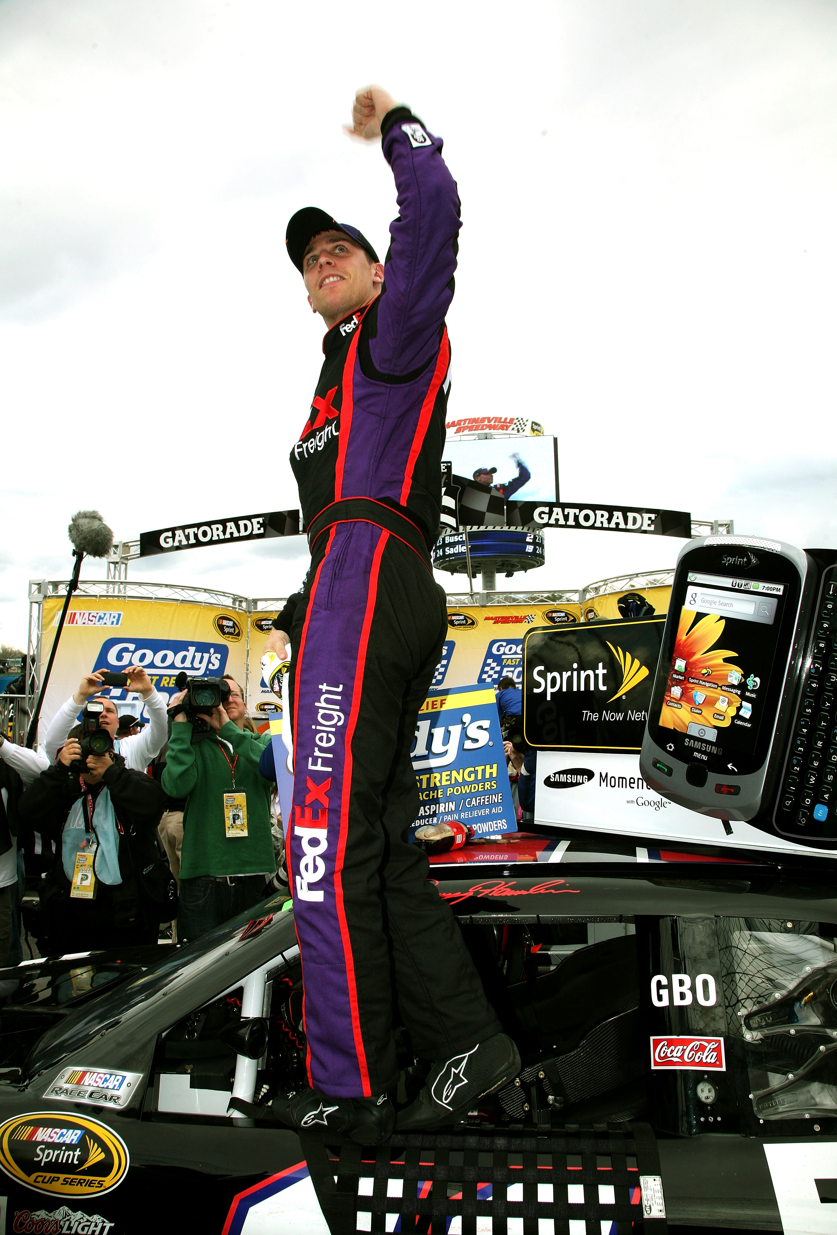 MARTINSVILLE, VA - MARCH 29:  Denny Hamlin celebrates in victory lane after driving the #11 FedEx Toyota to a win in the NASCAR Sprint Cup Series Goody's Fast Pain Relief 500 at Martinsville Speedway on March 29, 2010 in Martinsville, Virginia.  (Photo by