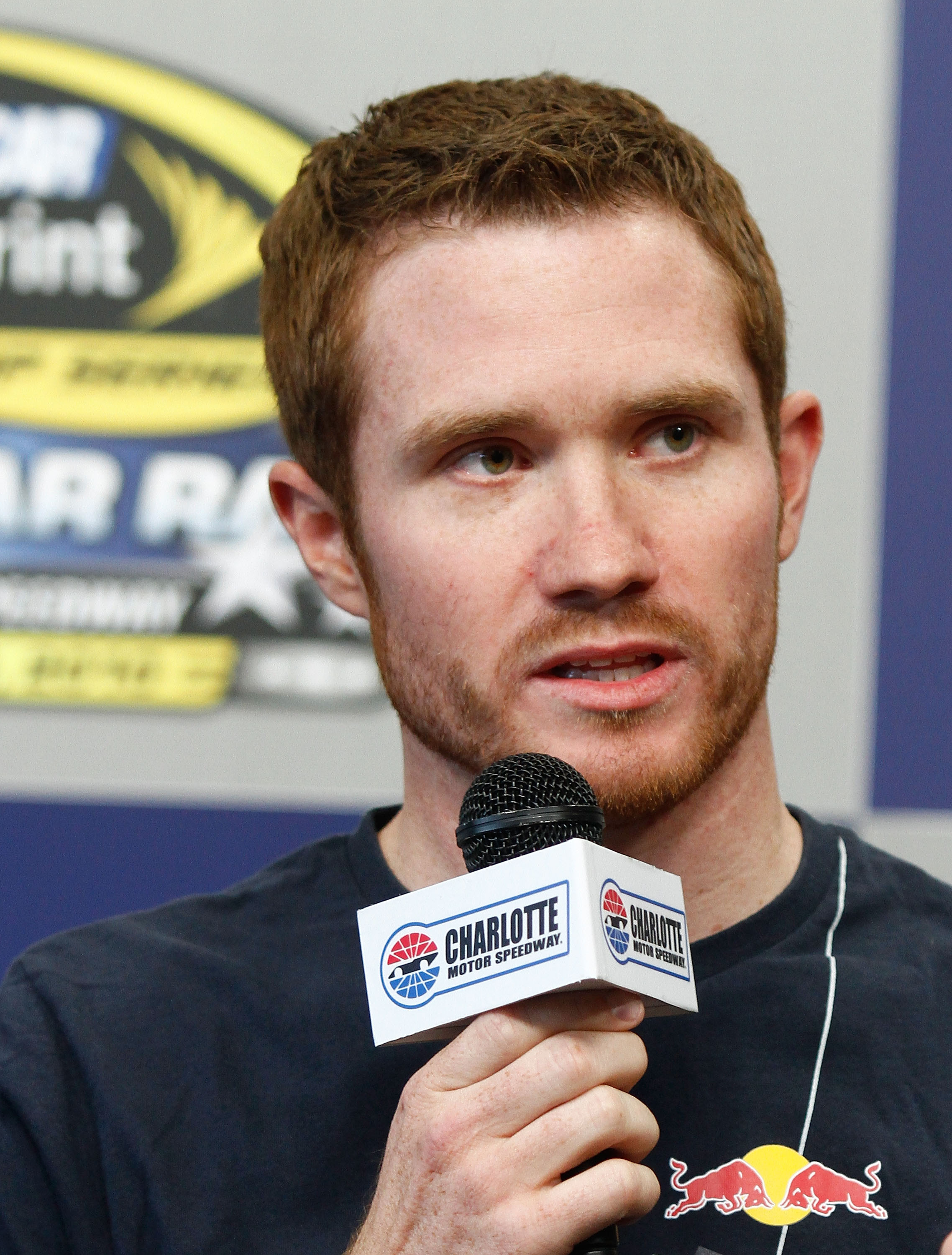 CONCORD, NC - MAY 21:  Brian Vickers, driver of the #83 Red Bull Toyota, speaks to the media during a press conference at Charlotte Motor Speedway on May 21, 2010 in Concord, North Carolina. Vickers will miss the remainder of the NASCAR season because of