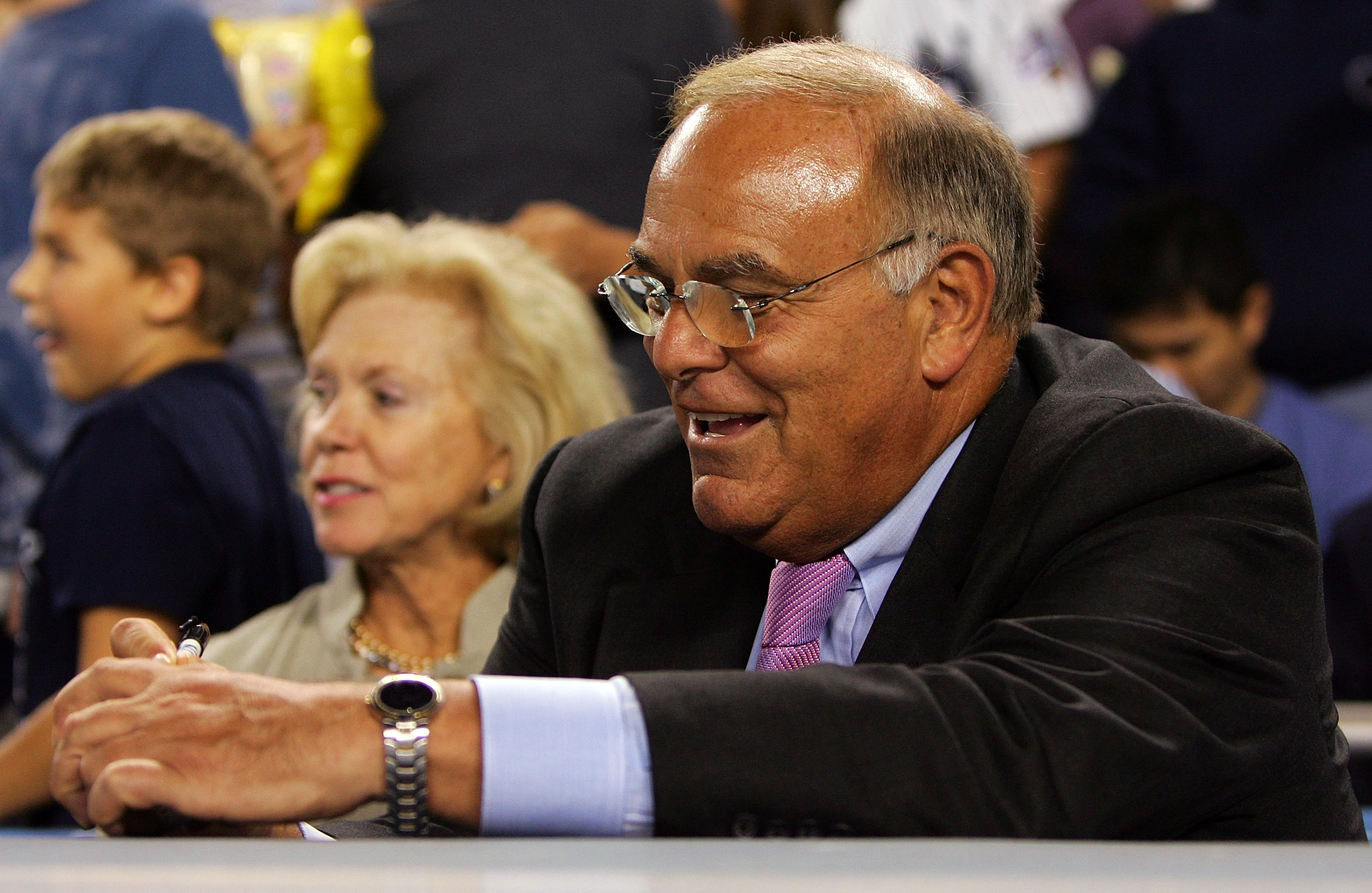 NEW YORK - SEPTEMBER 17:  Pennsylvania Gov. Ed Rendell signs a baseball as attends the game between the New York Yankees and the Chicago White Sox with his wife Midge September 17, 2008 at Yankee Stadium in the Bronx borough of New York City.  (Photo by J