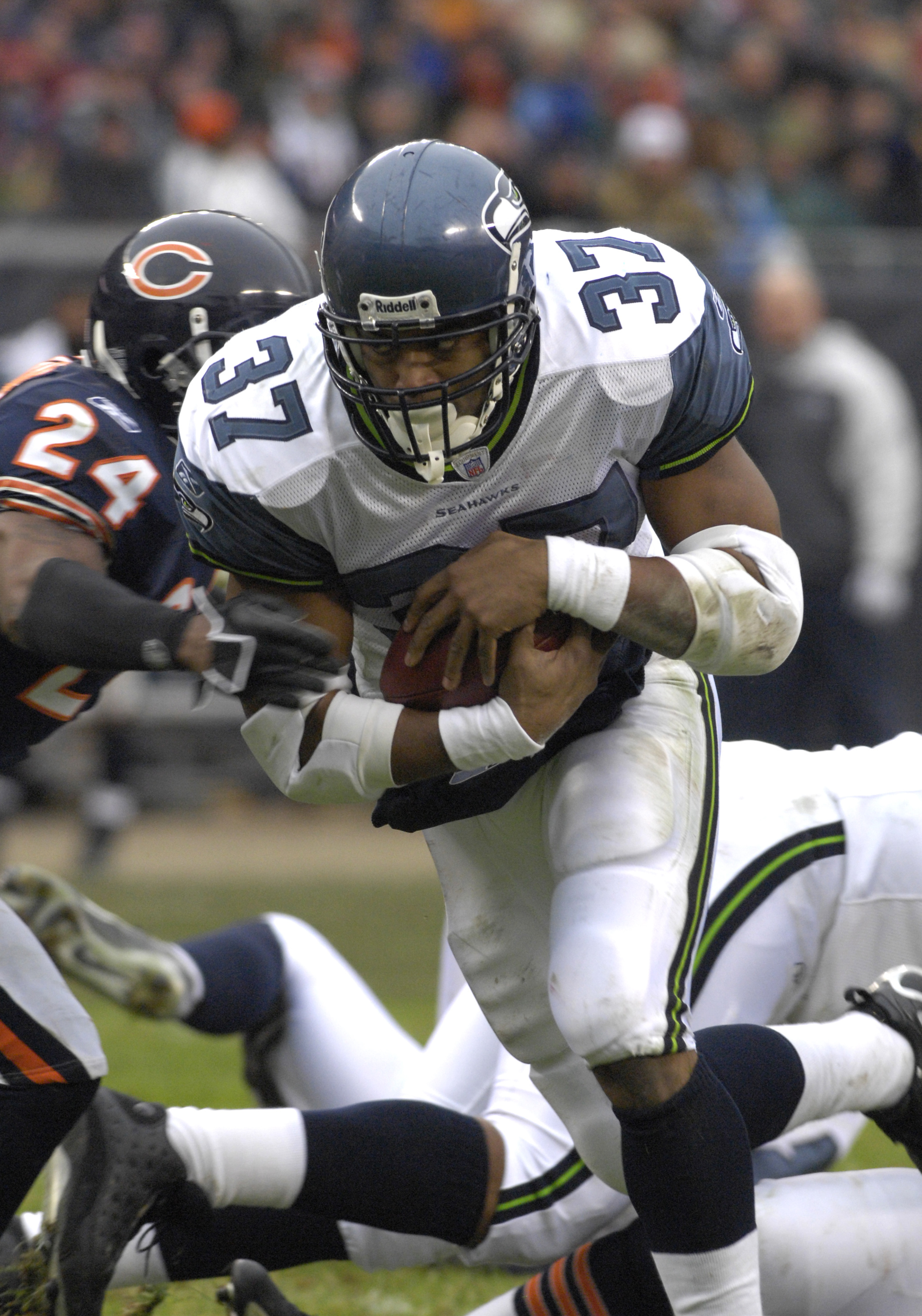 6861d65aa Seattle Seahawks running back Shaun Alexander rushes upfield against the  Chicago Bears in an NFC Divisional