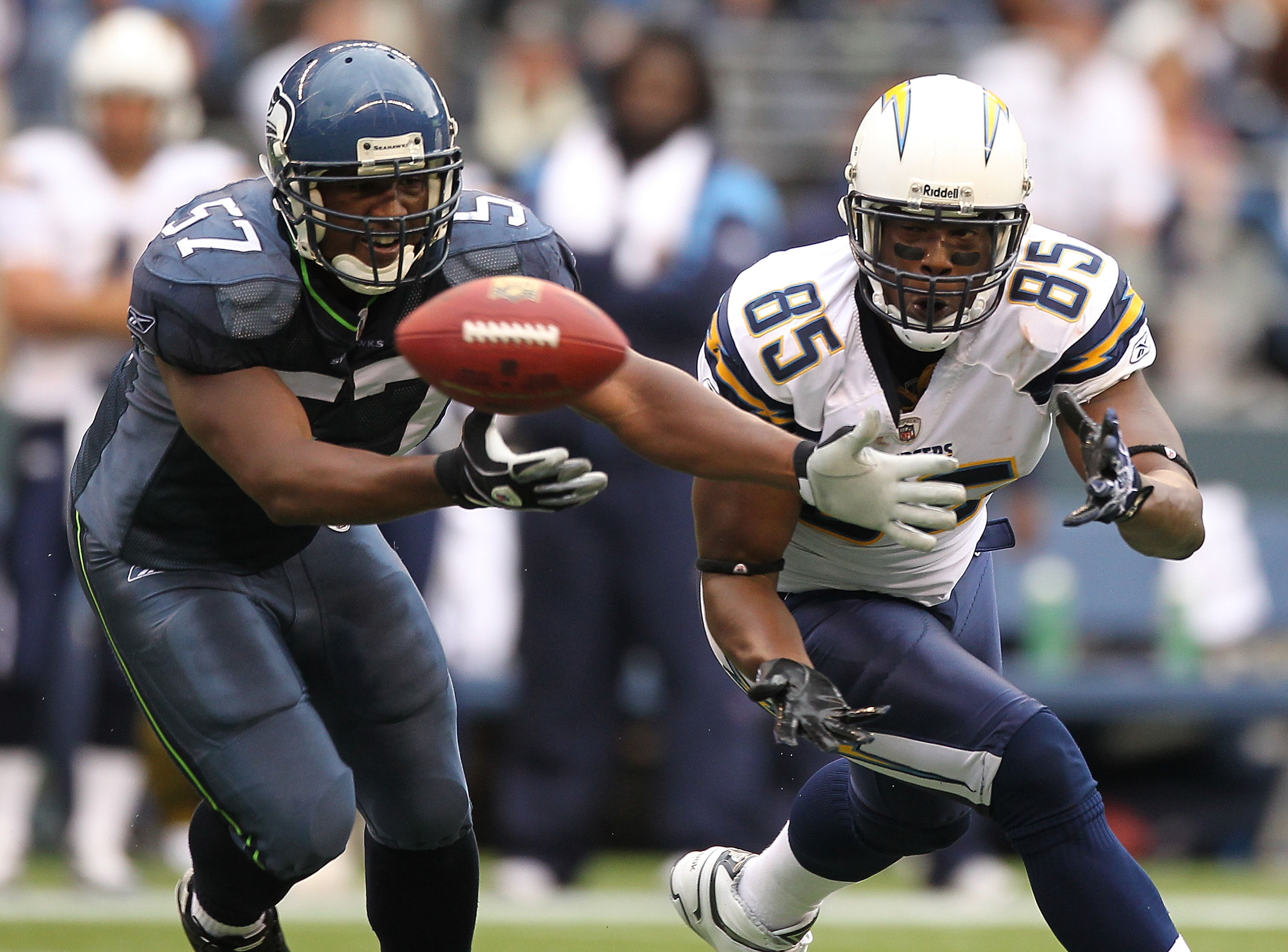 SEATTLE - SEPTEMBER 26:  Tight end Antonio Gates #85 of the San Diego Chargers attempts to catch a pass that is batted away by David Hawthorne #57 of the Seattle Seahawks at Qwest Field on September 26, 2010 in Seattle, Washington. The pass was then inter