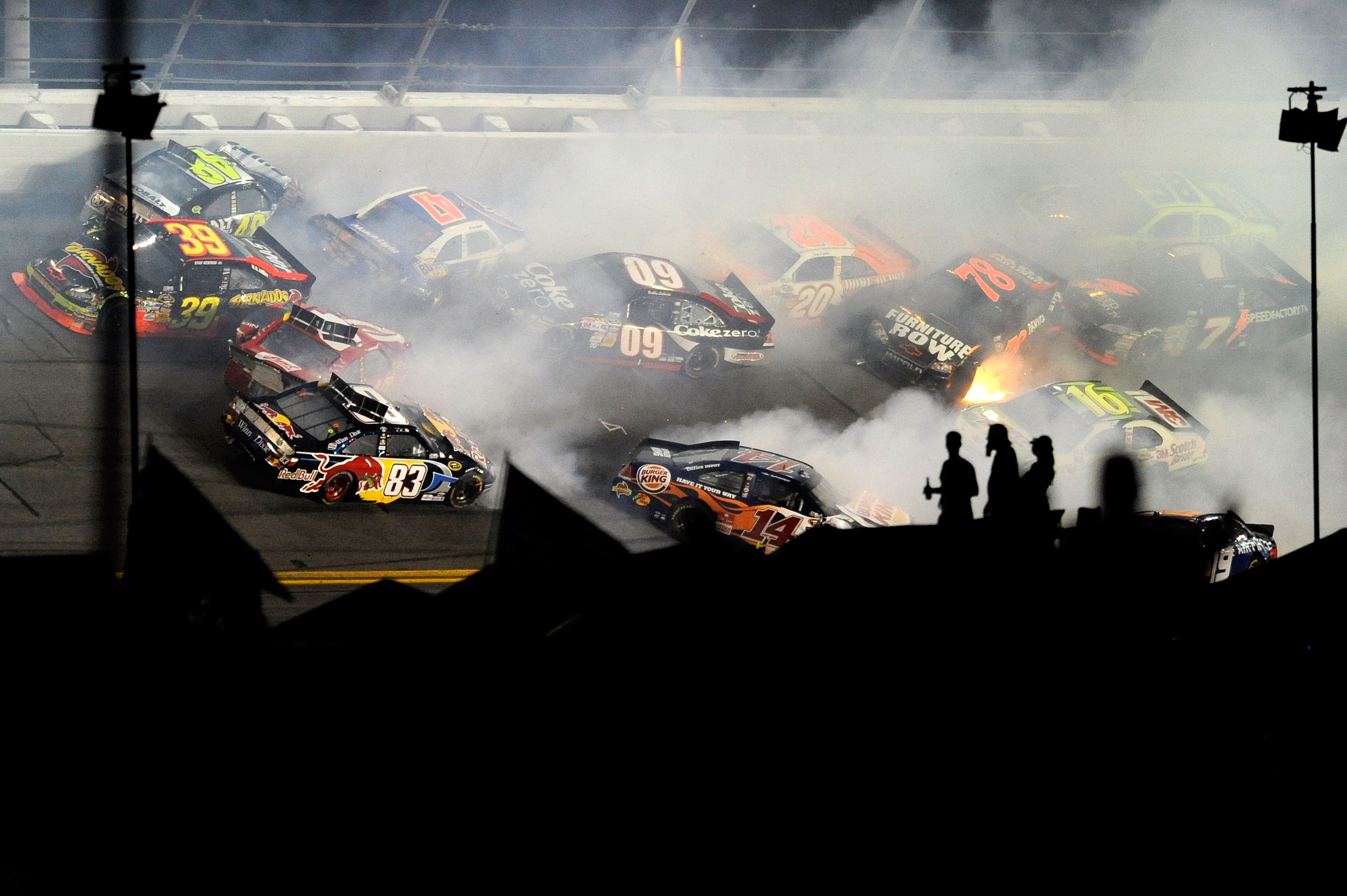 DAYTONA BEACH, FL - JULY 03:  A crash takes place on lap 148 during the NASCAR Sprint Cup Series Coke Zero 400 at Daytona International Speedway on July 3, 2010 in Daytona Beach, Florida.  (Photo by John Harrelson/Getty Images for NASCAR)