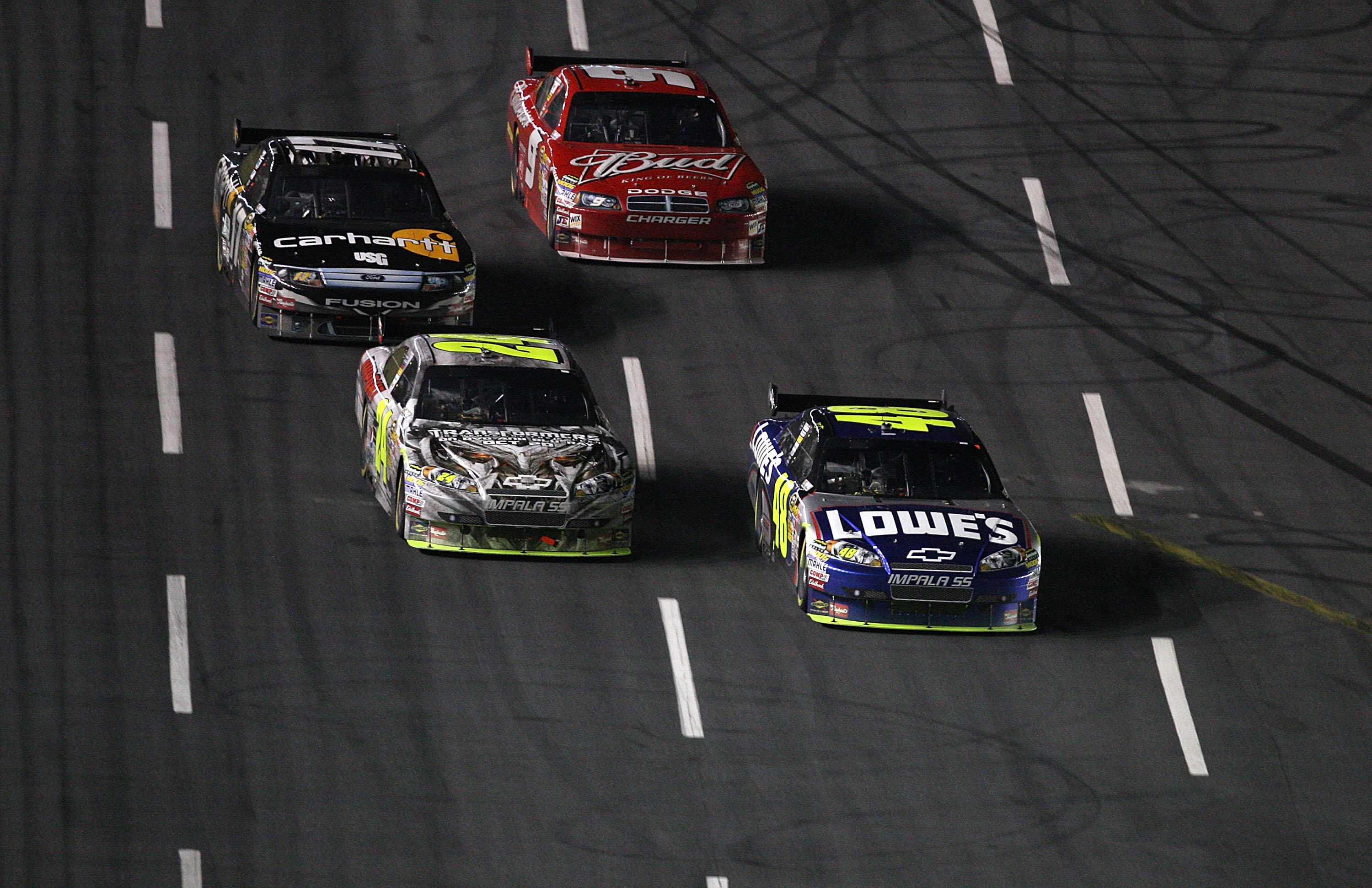CONCORD, NC - OCTOBER 17:  Jimmie Johnson, driver of the #48 Lowe's Chevrolet, races Jeff Gordon, driver of the #24 DuPont/Transformers 2 Chevrolet, Matt Kenseth, driver of the #17 Carhartt Ford, and Kasey Kahne, driver of the #9 Bedweiser Dodge, during t