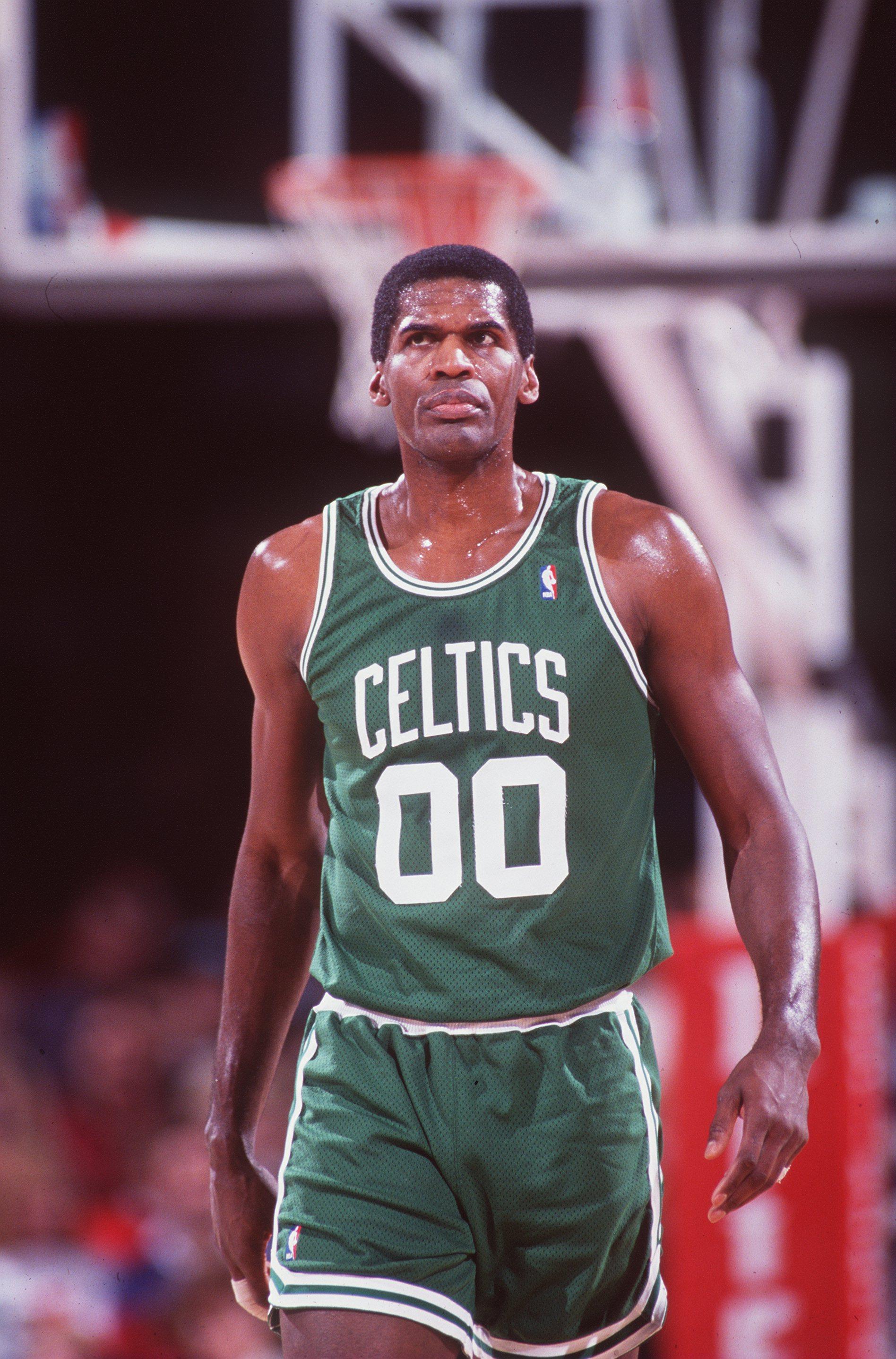 1992:  Center Robert Parish of the Boston Celtics walks up court during the Celtics versus Denver Nuggets game in Denver, Colorado.     Mandatory Credit: Tim DeFrisco/ALLSPORT