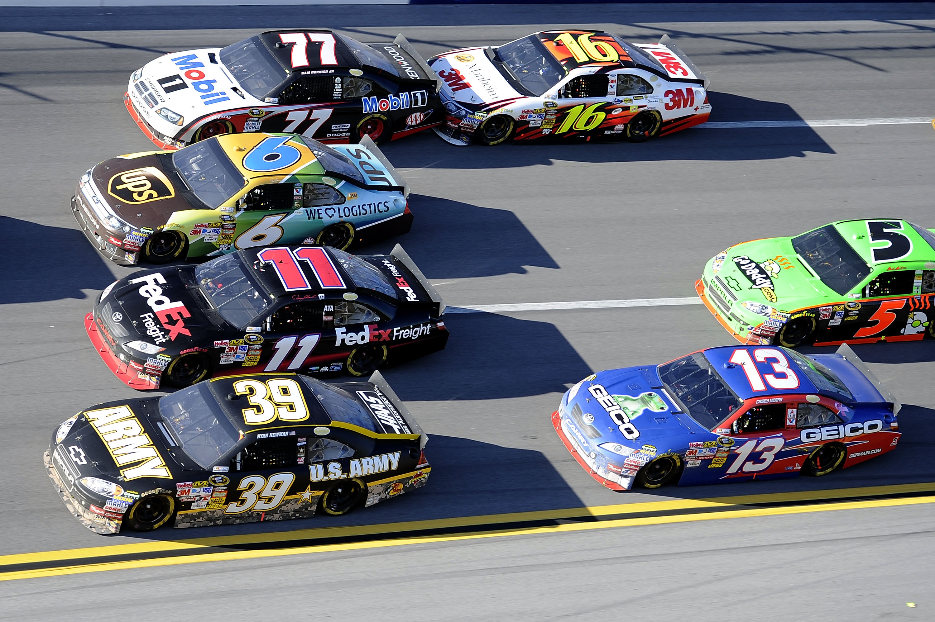 TALLADEGA, AL - OCTOBER 31:  Cars drive four lanes wide in turn three during the NASCAR Sprint Cup Series AMP Energy Juice 500 at Talladega Superspeedway on October 31, 2010 in Talladega, Alabama.  (Photo by John Harrelson/Getty Images for NASCAR)