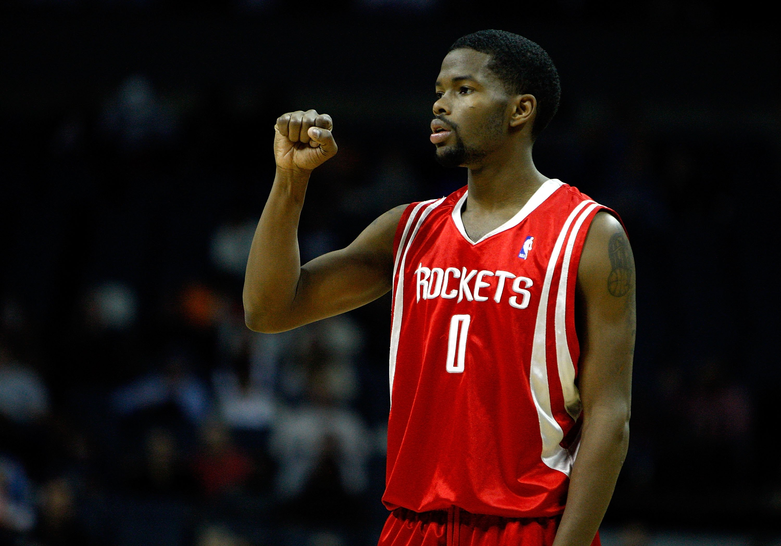CHARLOTTE, NC - JANUARY 12:  Aaron Brooks #0 of the Houston Rockets reacts during the game against the Charlotte Bobcats on January 12, 2010 at Time Warner Cable Arena in Charlotte, North Carolina.  The Bobcats won 102-94.  NOTE TO USER: User expressly ac