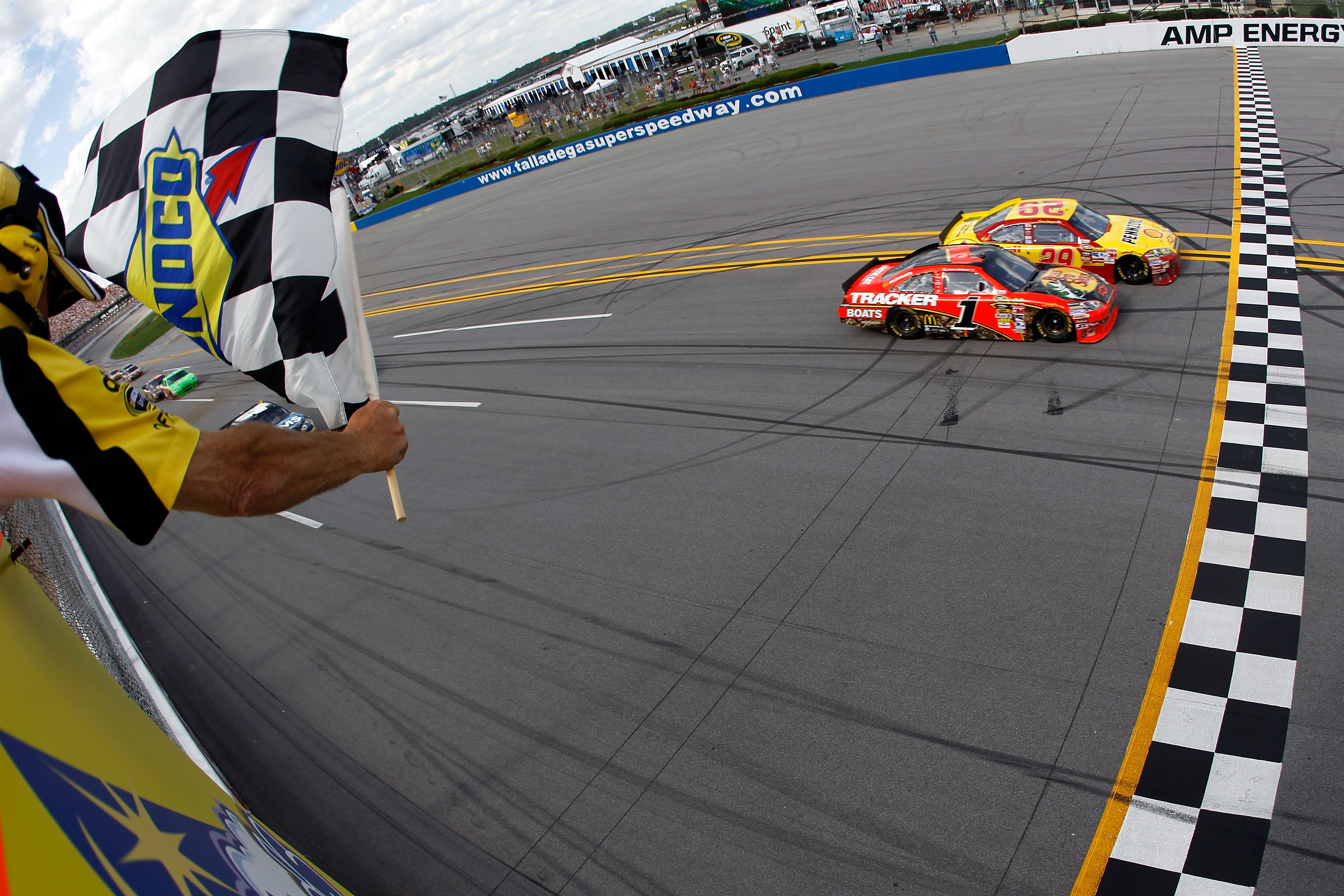 TALLADEGA, AL - APRIL 25:  Kevin Harvick, driver of the #29 Shell/Pennzoil Chevrolet, crosses the finish line ahead of Jamie McMurray, driver of the #1 Bass Pro Shops Chevrolet, to win the NASCAR Sprint Cup Series Aaron's 499 at Talladega Superspeedway on