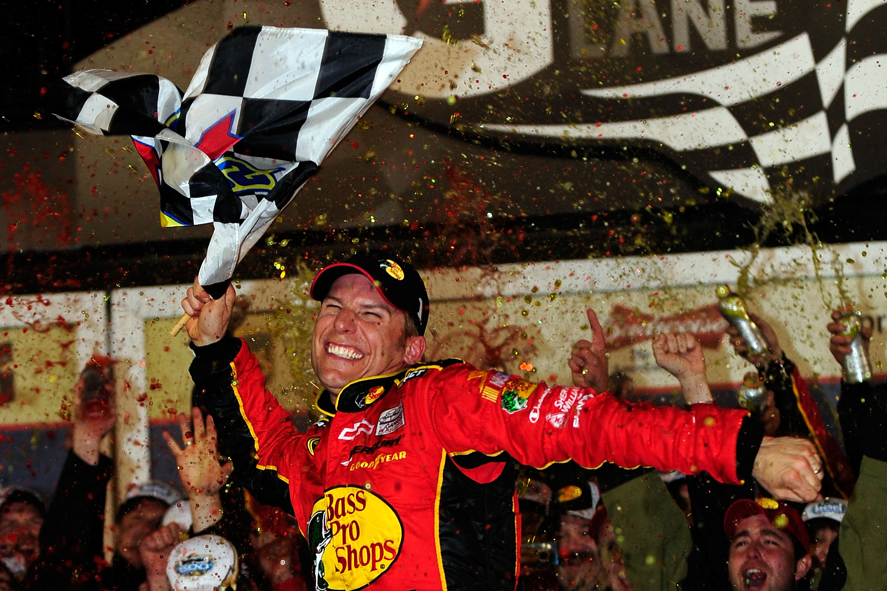 DAYTONA BEACH, FL - FEBRUARY 14:  Jamie McMurray, driver of the #1 Bass Pro Shops/Tracker Boats Chevrolet, celebrates in Victory Lane after winning the NASCAR Sprint Cup Series Daytona 500 at Daytona International Speedway on February 14, 2010 in Daytona