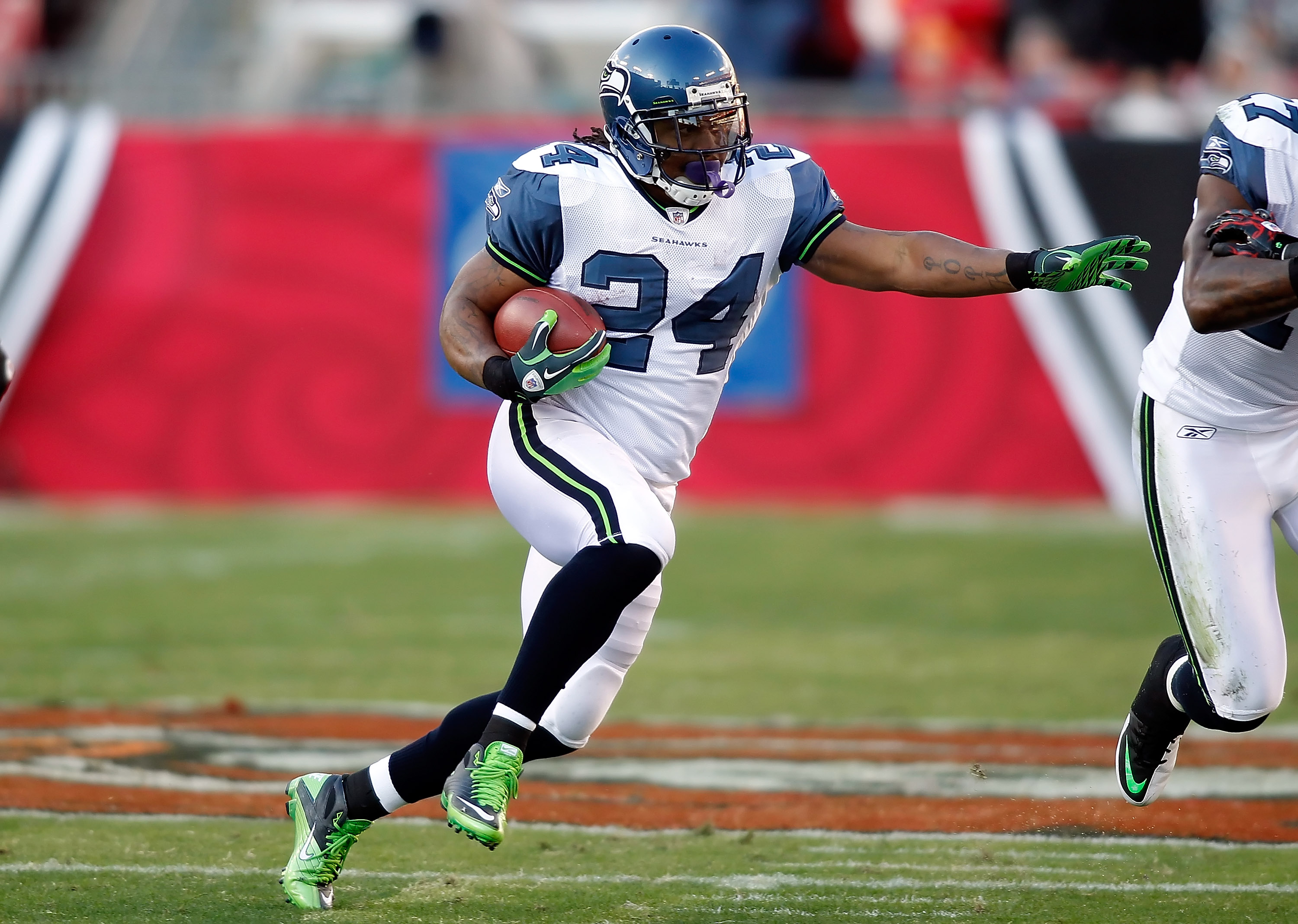 TAMPA, FL - DECEMBER 26: Running back Marshawn Lynch #24 of the Seattle Seahawks runs the ball against the Tampa Bay Buccaneers during the game at Raymond James Stadium on December 26, 2010 in Tampa, Florida. (Photo by J. Meric/Getty Images)
