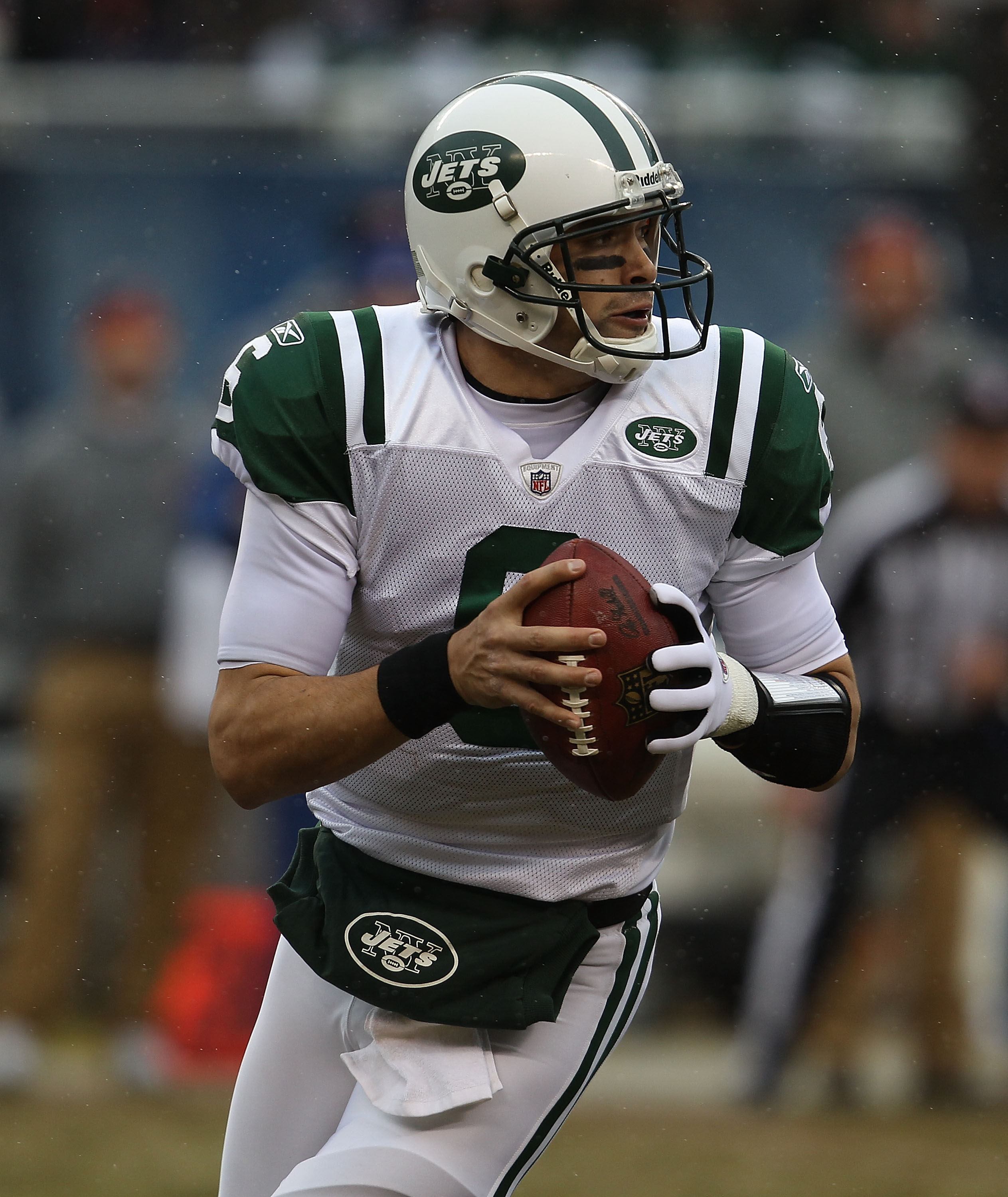 CHICAGO, IL - DECEMBER 26: Mark Sanchez #6 of the New York Jets rolls out to look for a receiver against the Chicago Bears at Soldier Field on December 26, 2010 in Chicago, Illinois. The Bears defeated the Jets 38-34. (Photo by Jonathan Daniel/Getty Image