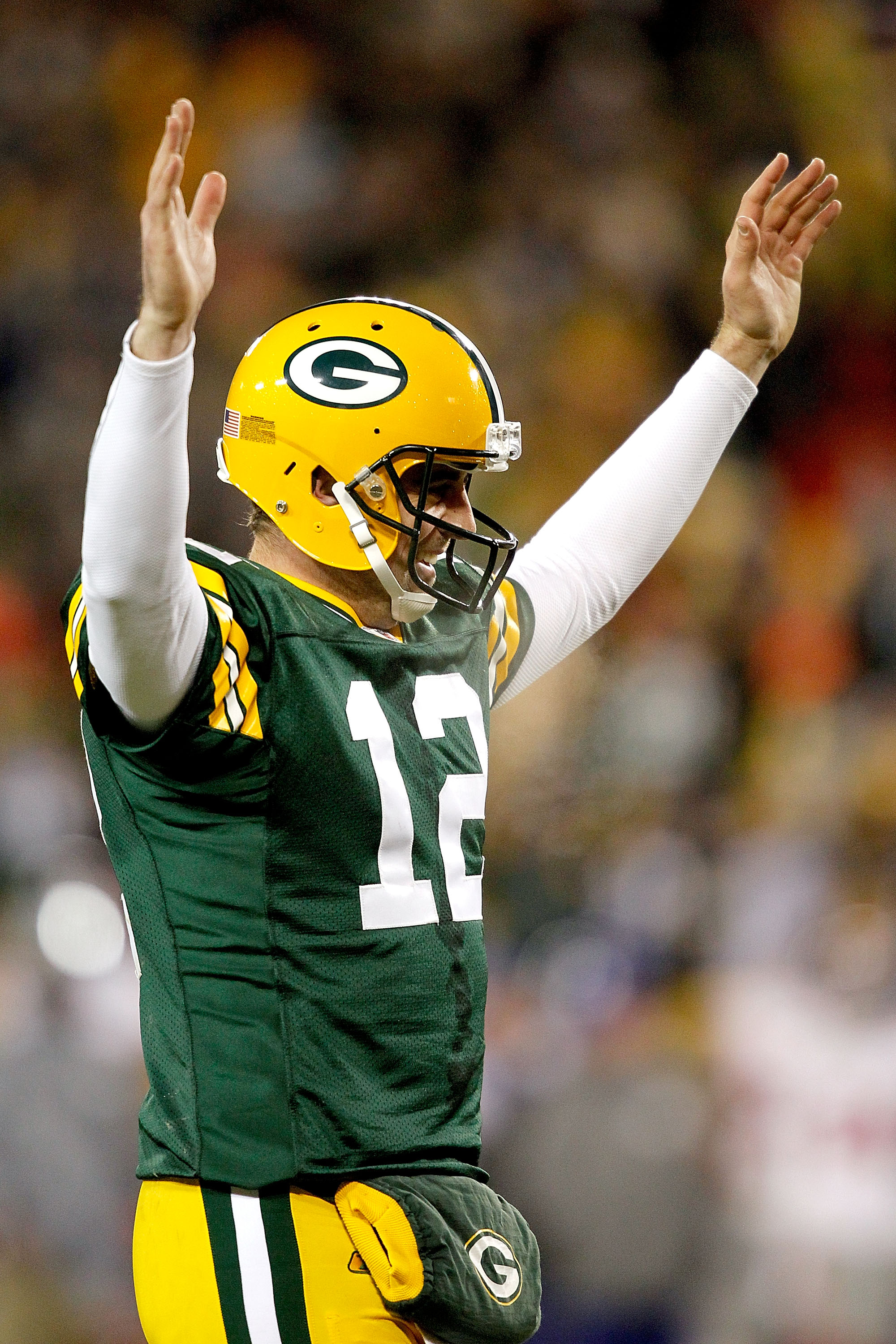GREEN BAY, WI - DECEMBER 26:  Aaron Rodgers #12 of the Green Bay Packers is celebrates a touchdown against the New York Giants at Lambeau Field on December 26, 2010 in Green Bay, Wisconsin.  (Photo by Matthew Stockman/Getty Images)