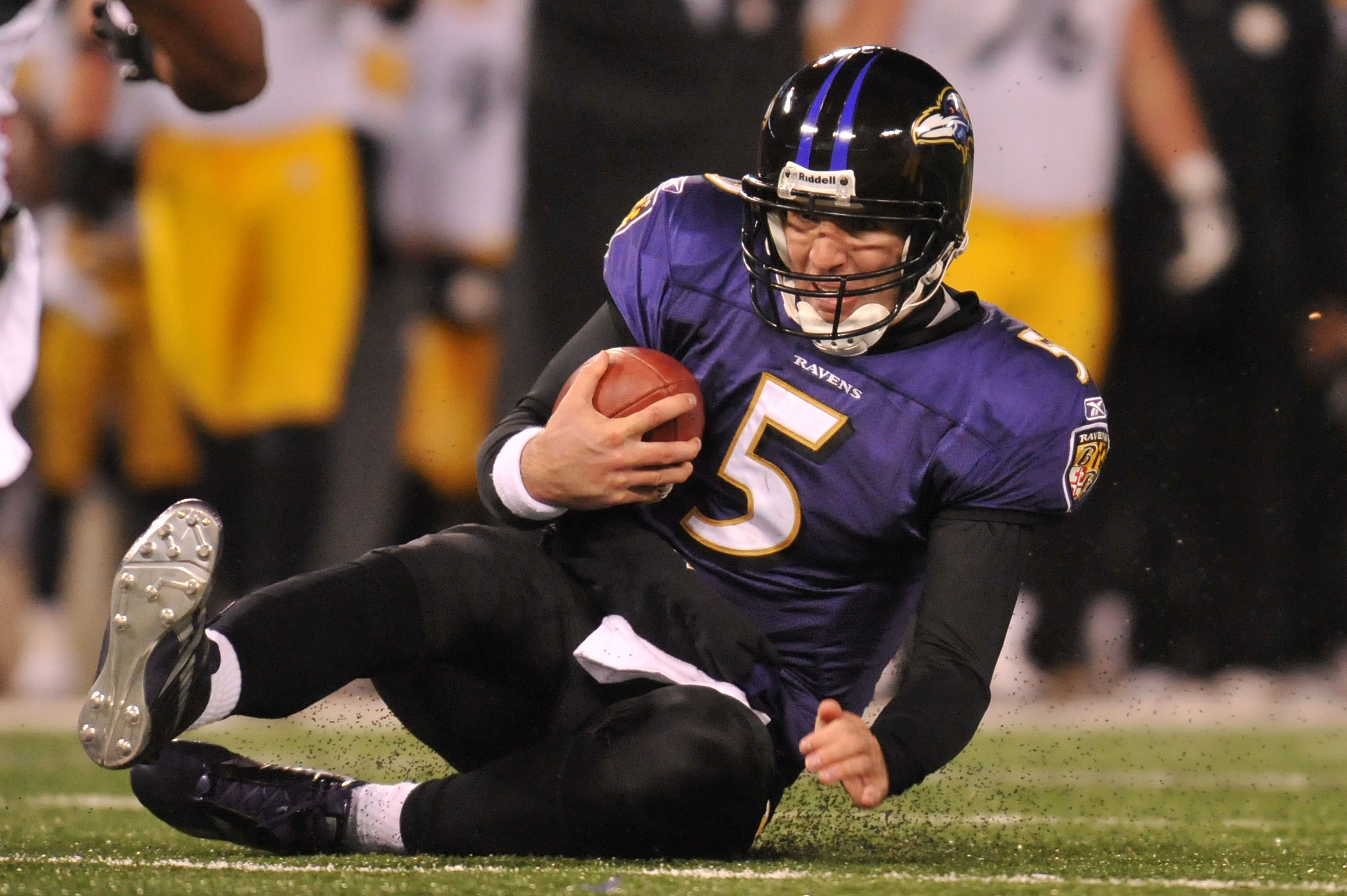 BALTIMORE, MD - DECEMBER 05:  Quarterback Joe Flacco #5 of the Baltimore Ravens lands on the ground during the game against the Pittsburgh Steelers at M&T Bank Stadium on December 5, 2010 in Baltimore, Maryland. Pittsburgh won 13-10.  (Photo by Larry Fren