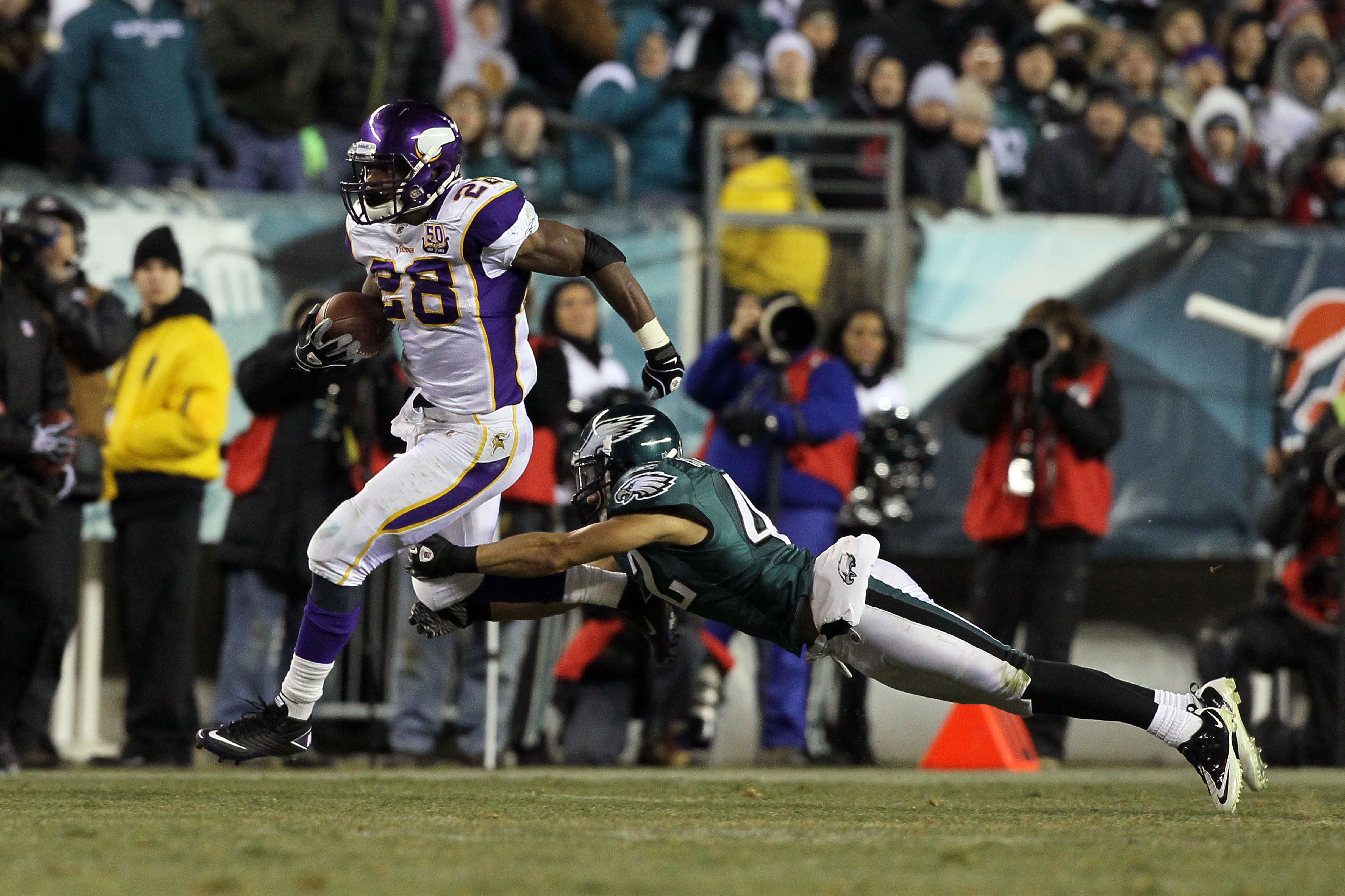 PHILADELPHIA, PA - DECEMBER 26:  Adrian Peterson #28 of the Minnesota Vikings runs against Kurt Coleman #42 of the Philadelphia Eagles at Lincoln Financial Field on December 26, 2010 in Philadelphia, Pennsylvania.  (Photo by Jim McIsaac/Getty Images)