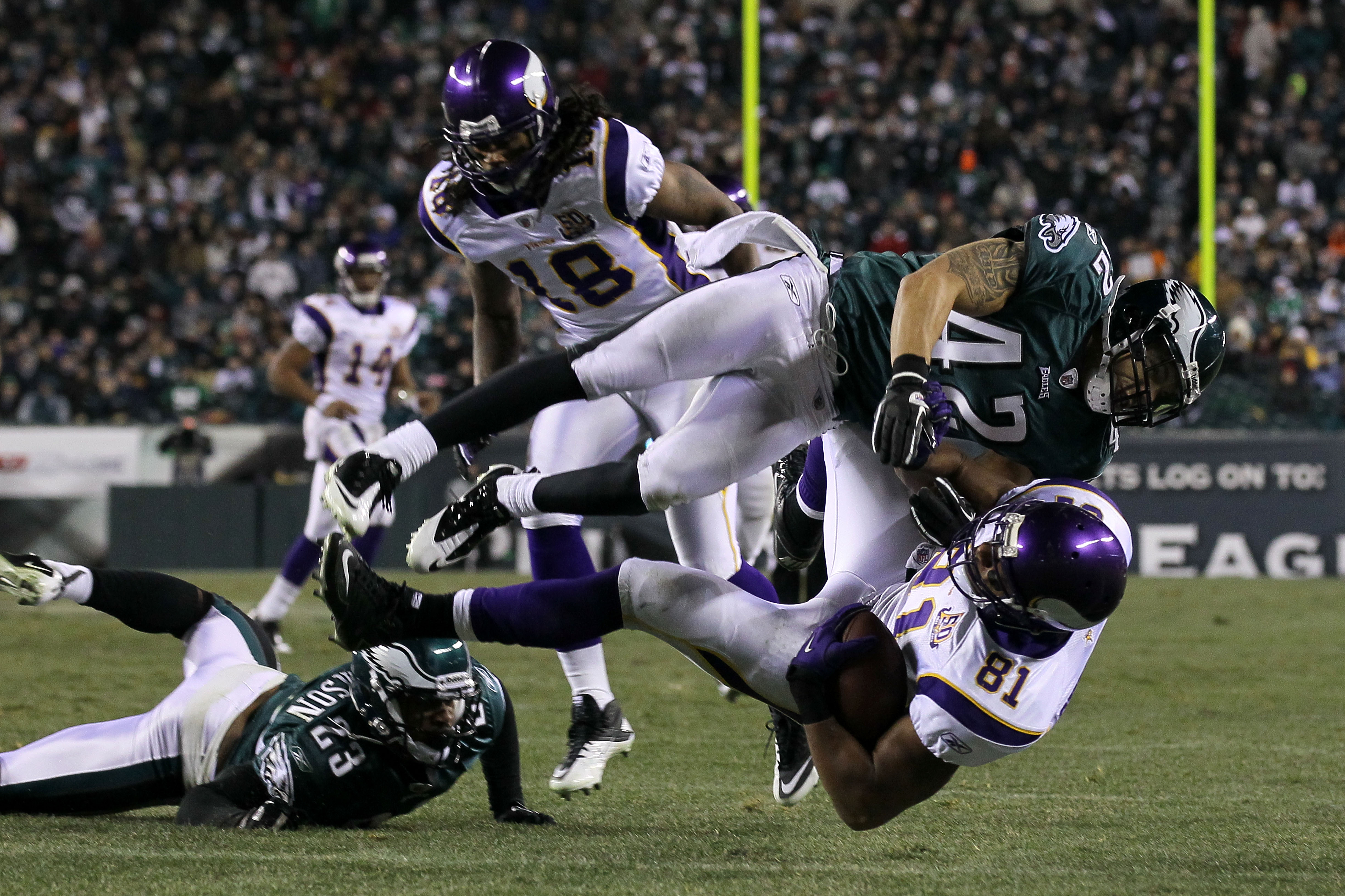PHILADELPHIA, PA - DECEMBER 26:  Kurt Coleman #42 of the Philadelphia Eagles tackles Visanthe Shiancoe #81 of the Minnesota Vikings at Lincoln Financial Field on December 26, 2010 in Philadelphia, Pennsylvania.  (Photo by Jim McIsaac/Getty Images)