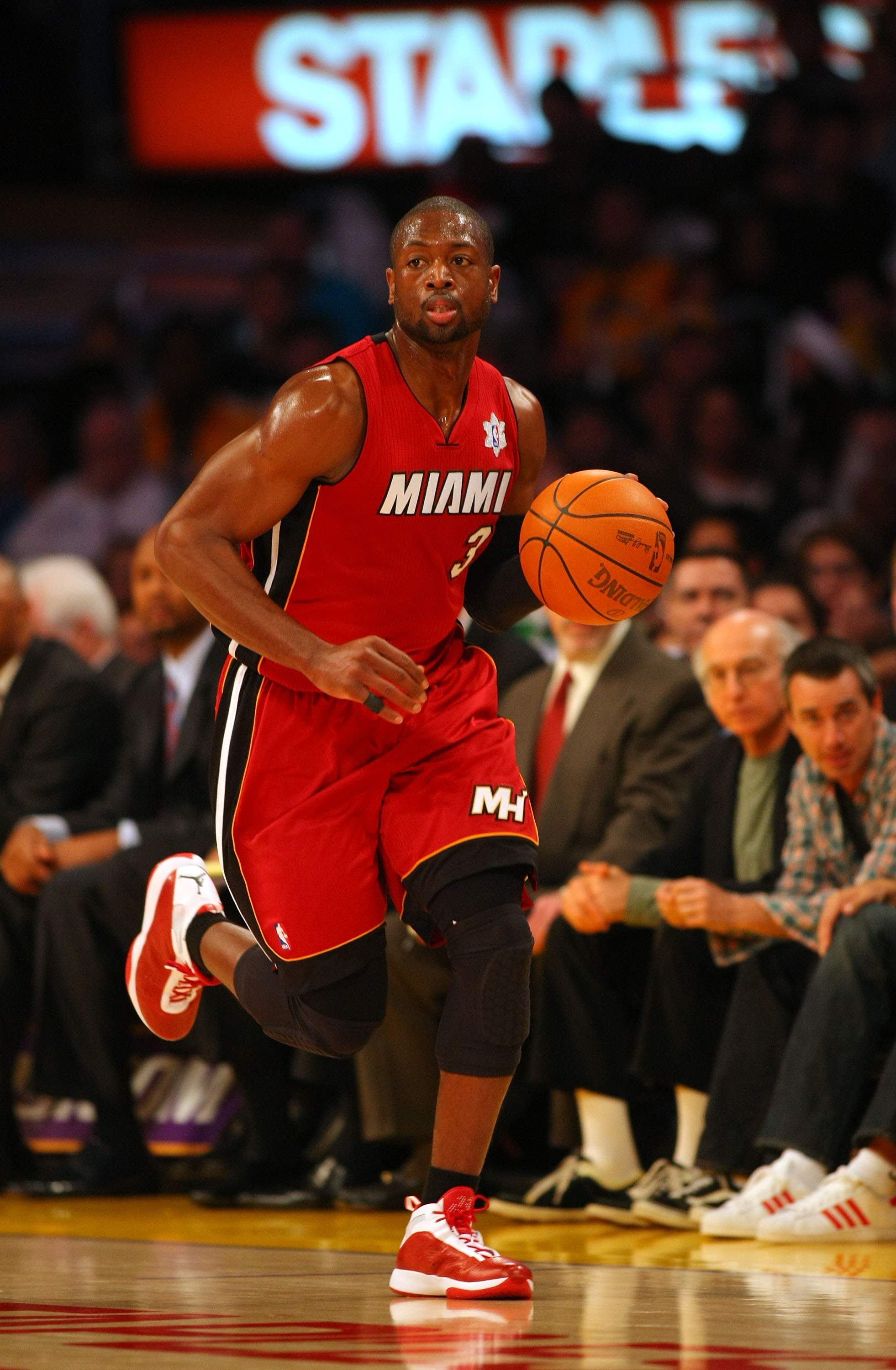 LOS ANGELES, CA - DECEMBER 25:  Dwyane Wade #3 of the Miami Heat dribbles the ball upcourt during the NBA game against the Los Angeles Lakers at Staples Center on December 25, 2010 in Los Angeles, California. The Heat defeated the Lakers 96-80. NOTE TO US