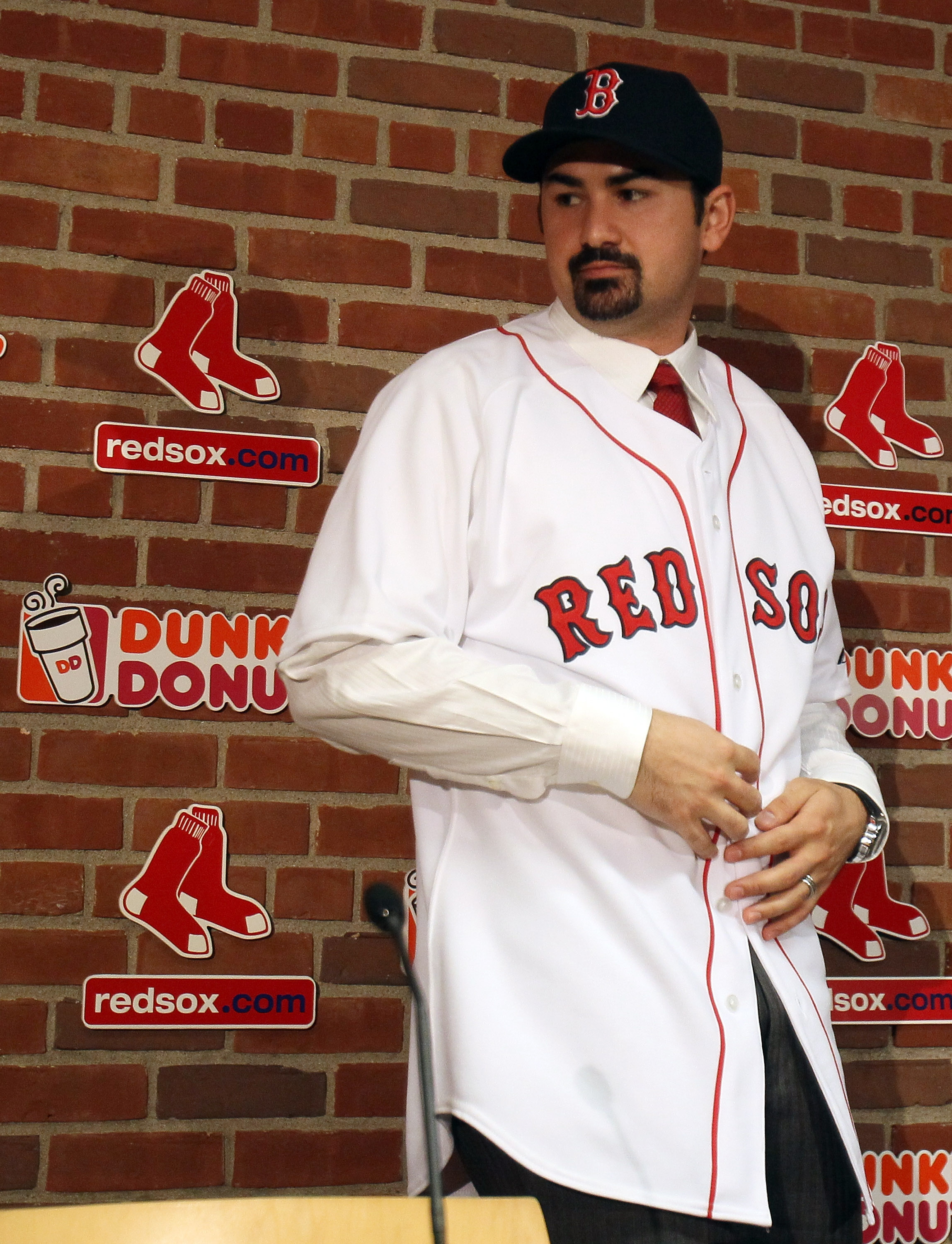 BOSTON, MA - DECEMBER 06:  Adrian Gonzalez stands after a press conference to announce his signing with the Boston Red Sox on December 6,  2010 at the Fenway Park in Boston, Massachusetts.  (Photo by Elsa/Getty Images)