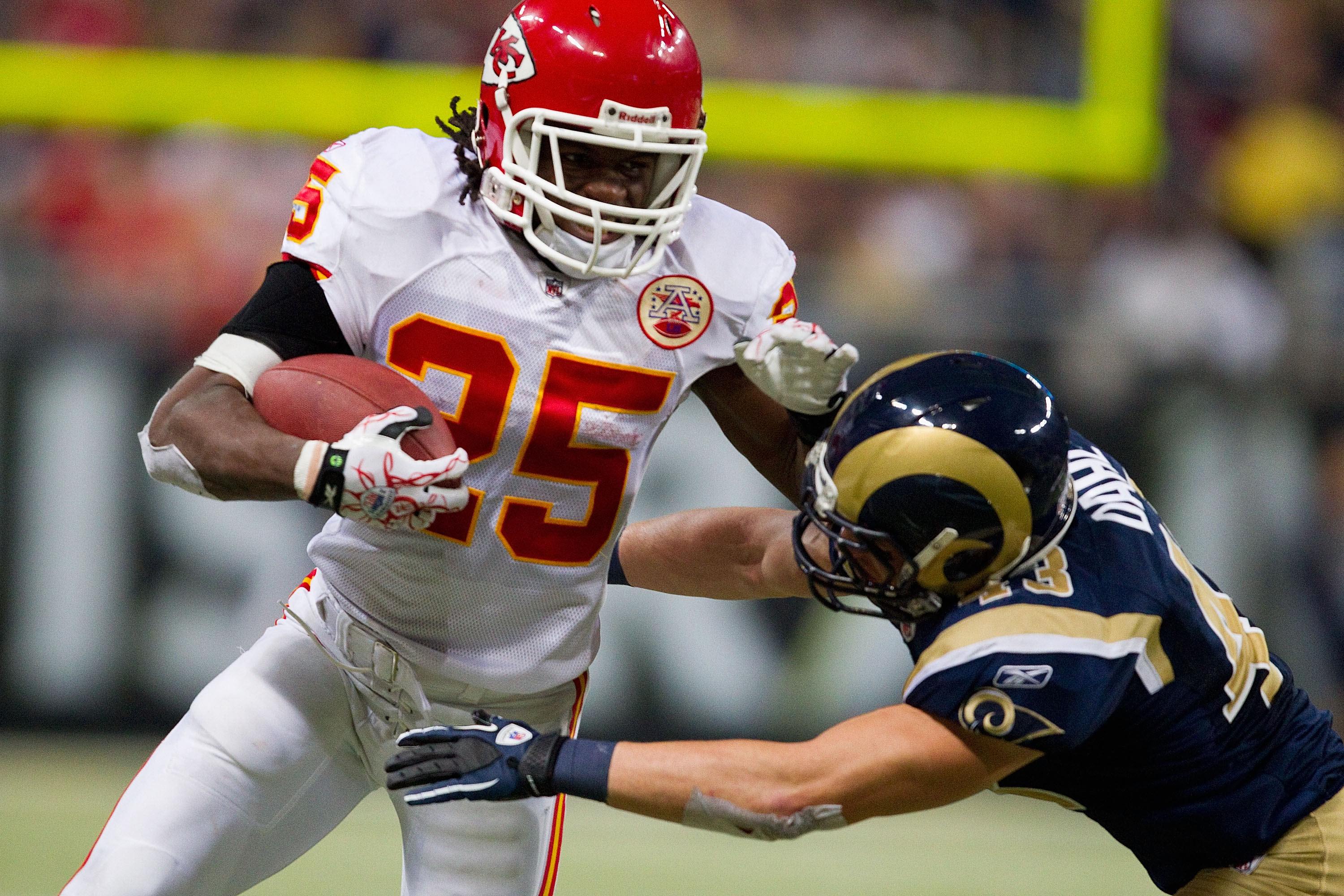 ST. LOUIS, MO - DECEMBER 19: Jamaal Charles #25 of the Kansas City Chiefs looks to get by Craig Dahl #43 of the St. Louis Rams at the Edward Jones Dome on December 19, 2010 in St. Louis, Missouri.  The Chiefs beat the Rams 27-13.  (Photo by Dilip Vishwana