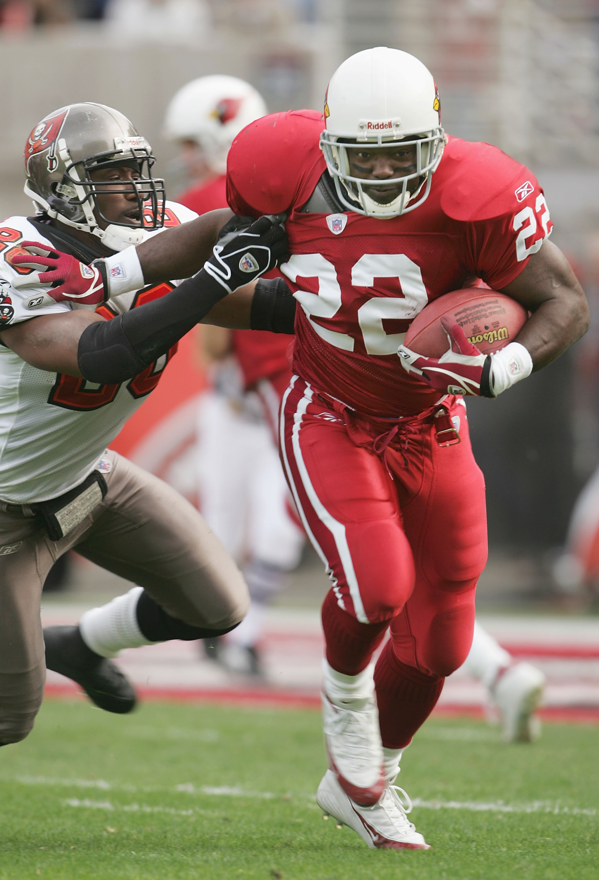 TEMPE, AZ - JANUARY 2:  Runningback Emmitt Smith #22 of the Arizona Cardinals carries the ball under pressure from Dexter Jackson #28 of the Tampa Bay Buccaneers at Sun Devil Stadium on January 2, 2005 in Tempe, Arizona. The Cardinals defeated the Buccane