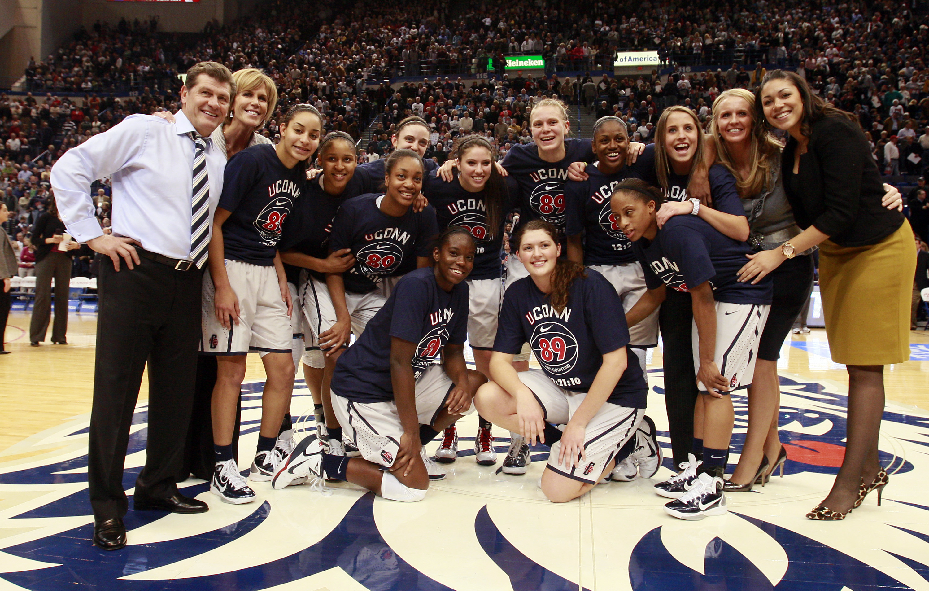 HARTFORD, CT - DECEMBER 21:  Coach Geno Auriemma of Connecticut and his team pose for a picture after defeating Florida State on December 21, 2010 in Hartford, Connecticut. Connecticut set a record with 89 straight wins without a defeat. Connecticut set a