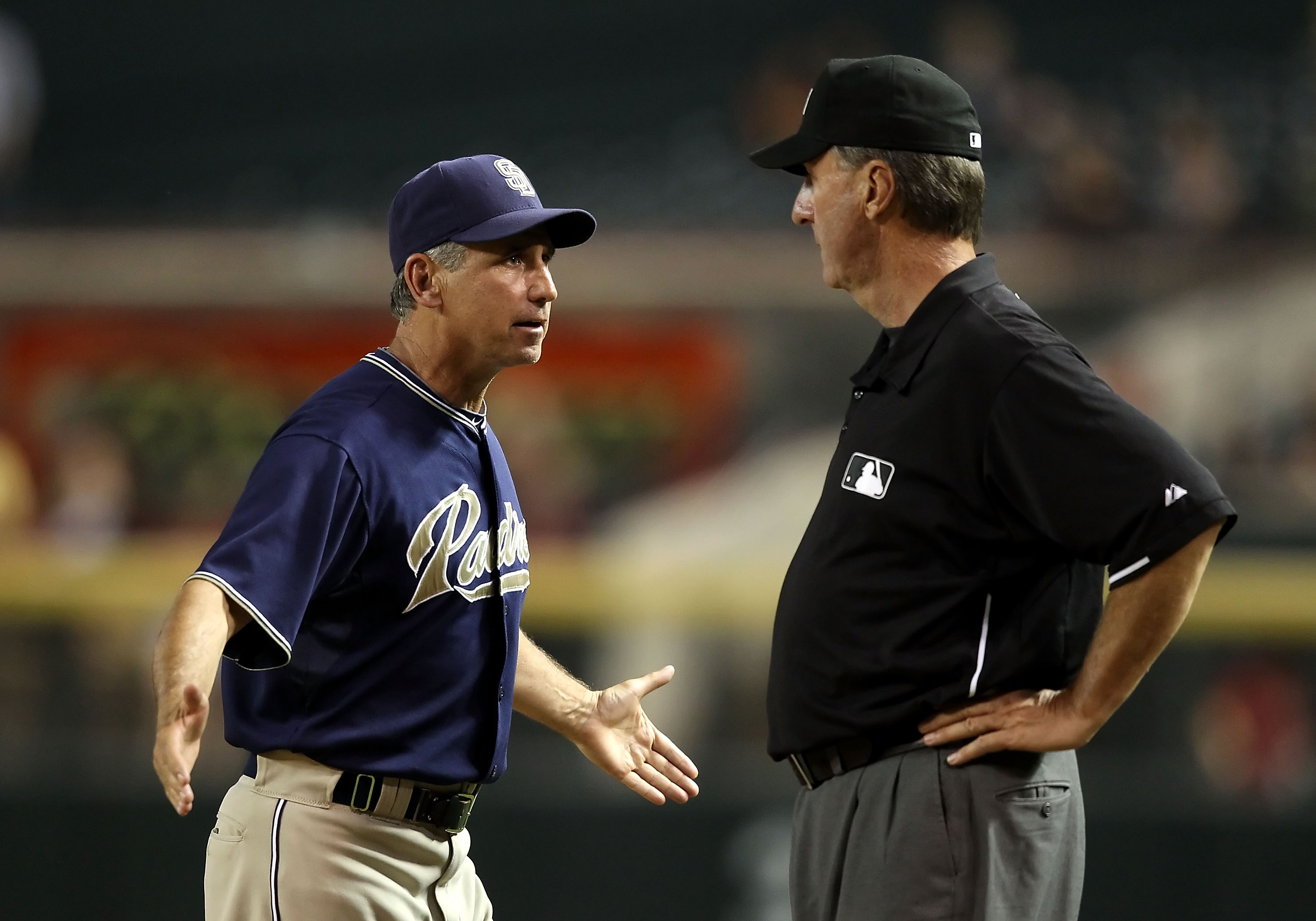 PHOENIX - AUGUST 30:  Manager Bud Black of the San Diego Padres reacts to first base umpire Tim McClelland after a disputed call during the fifth inning of the Major League Baseball game against the Arizona Diamondbacks at Chase Field on August 30, 2010 i