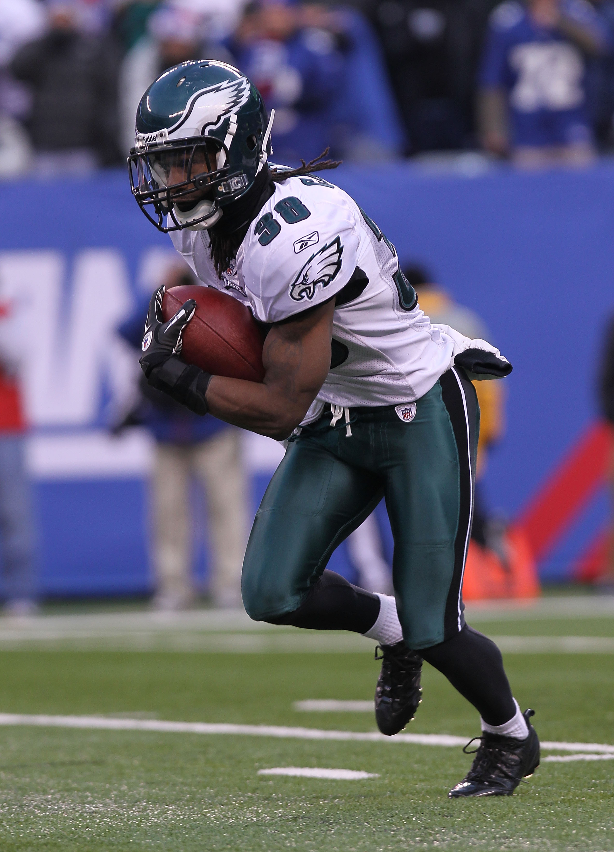 EAST RUTHERFORD, NJ - DECEMBER 19:  Jorrick Calvin #38 of the Philadelphia Eagles rushes against the New York Giants at New Meadowlands Stadium on December 19, 2010 in East Rutherford, New Jersey.  (Photo by Nick Laham/Getty Images)