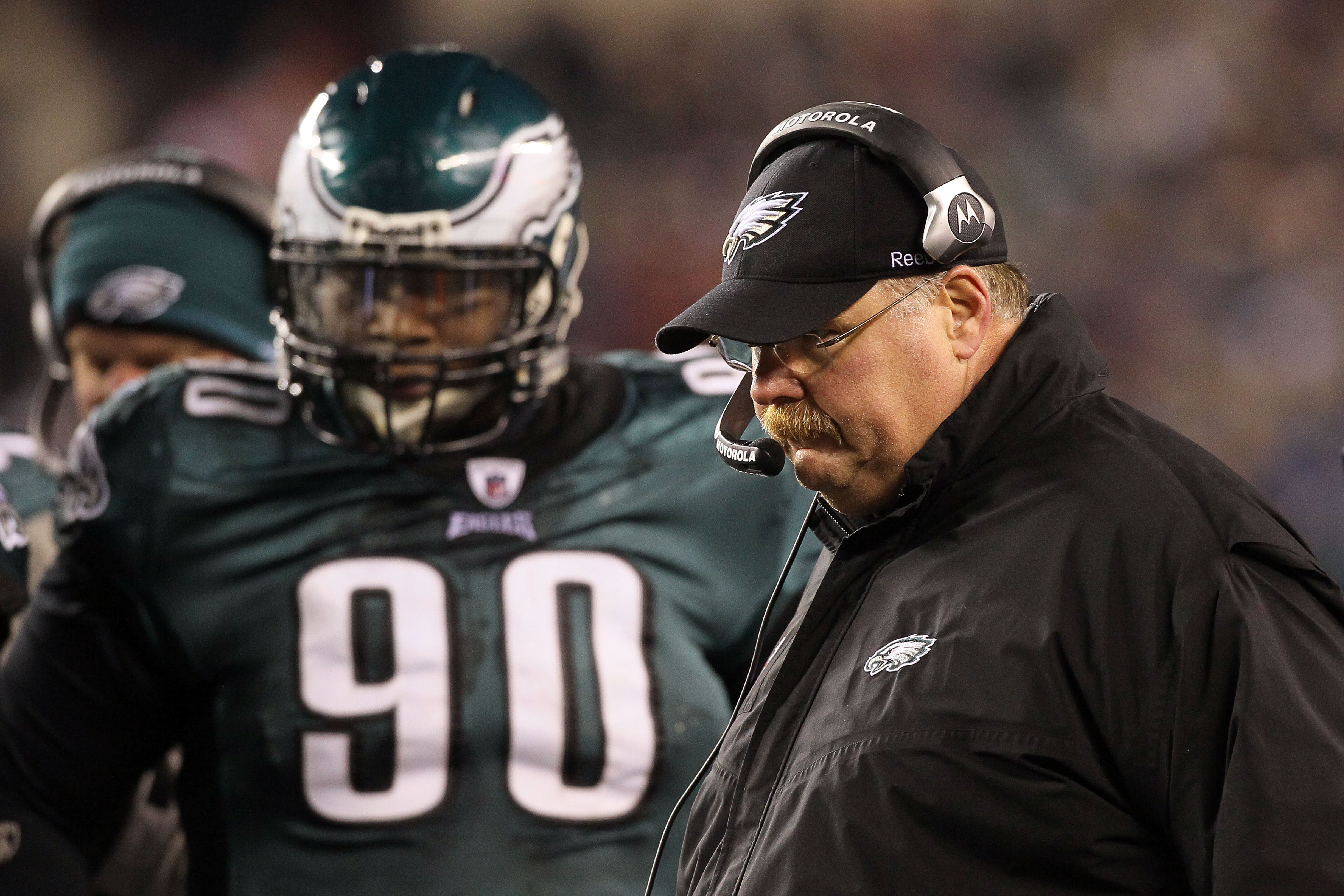 PHILADELPHIA, PA - DECEMBER 26:  Head Coach Andy Reid (R) of the Philadelphia Eagles stands on the sidelines with Antonio Dixon #90 during their game against the Minnesota Vikings at Lincoln Financial Field on December 26, 2010 in Philadelphia, Pennsylvan