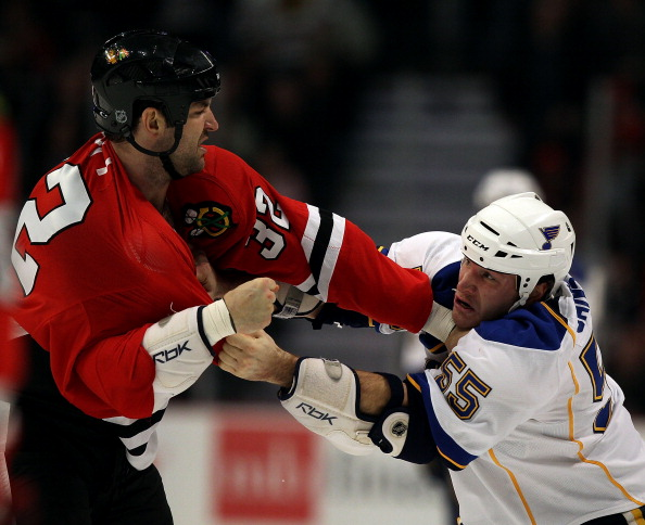 CHICAGO - NOVEMBER 30: John Scott #32 of the Chicago Blackhawks fights with Cam Janssen #55 of the St. Louis Blues at the United Center on November 30, 2010 in Chicago, Illinois. (Photo by Jonathan Daniel/Getty Images)