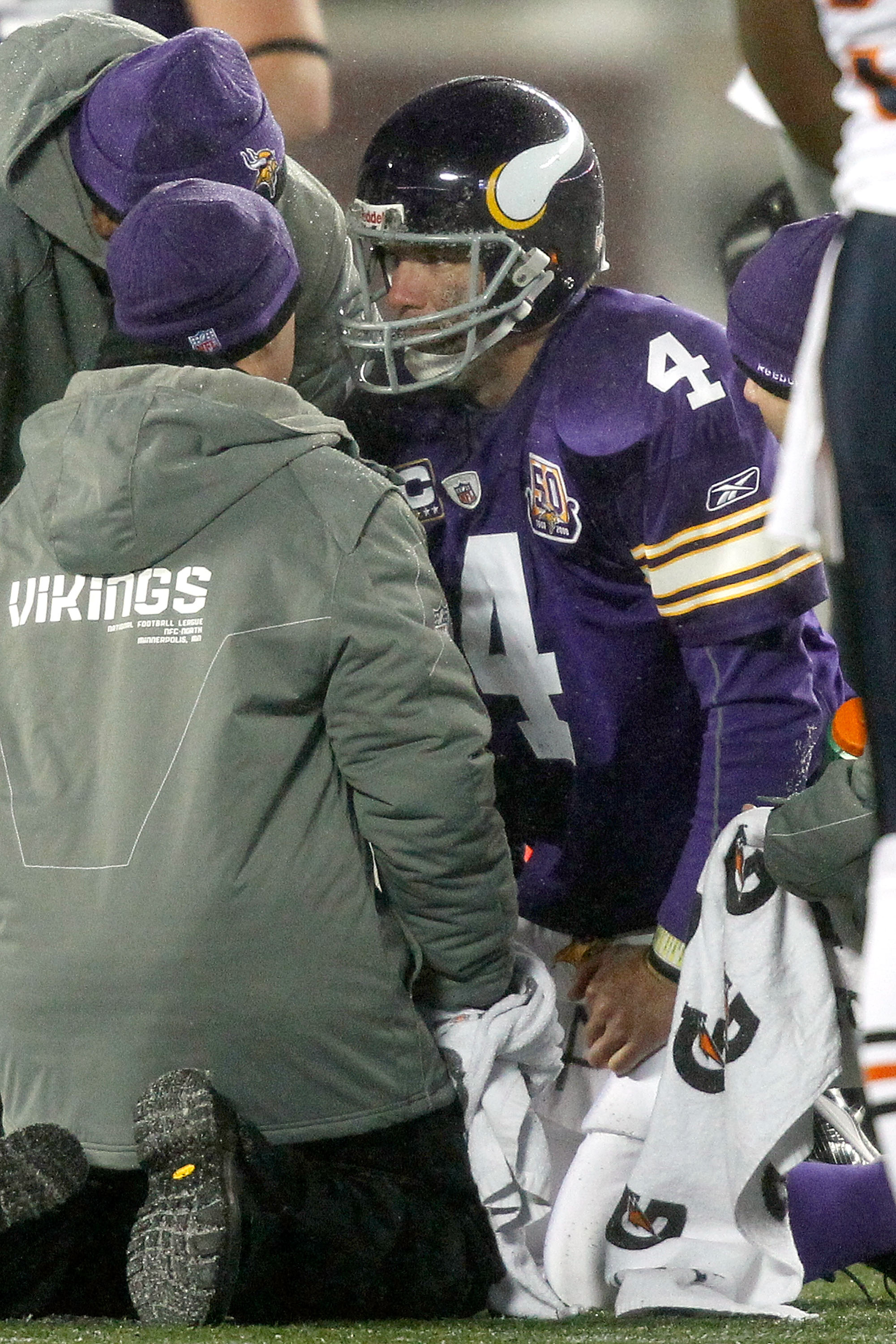 MINNEAPOLIS, MN - DECEMBER 20:  Quarterback Brett Favre #4 of the Minnesota Vikings is attended to after being sacked by the Chicago Bears at TCF Bank Stadium on December 20, 2010 in Minneapolis, Minnesota.  (Photo by Matthew Stockman/Getty Images)