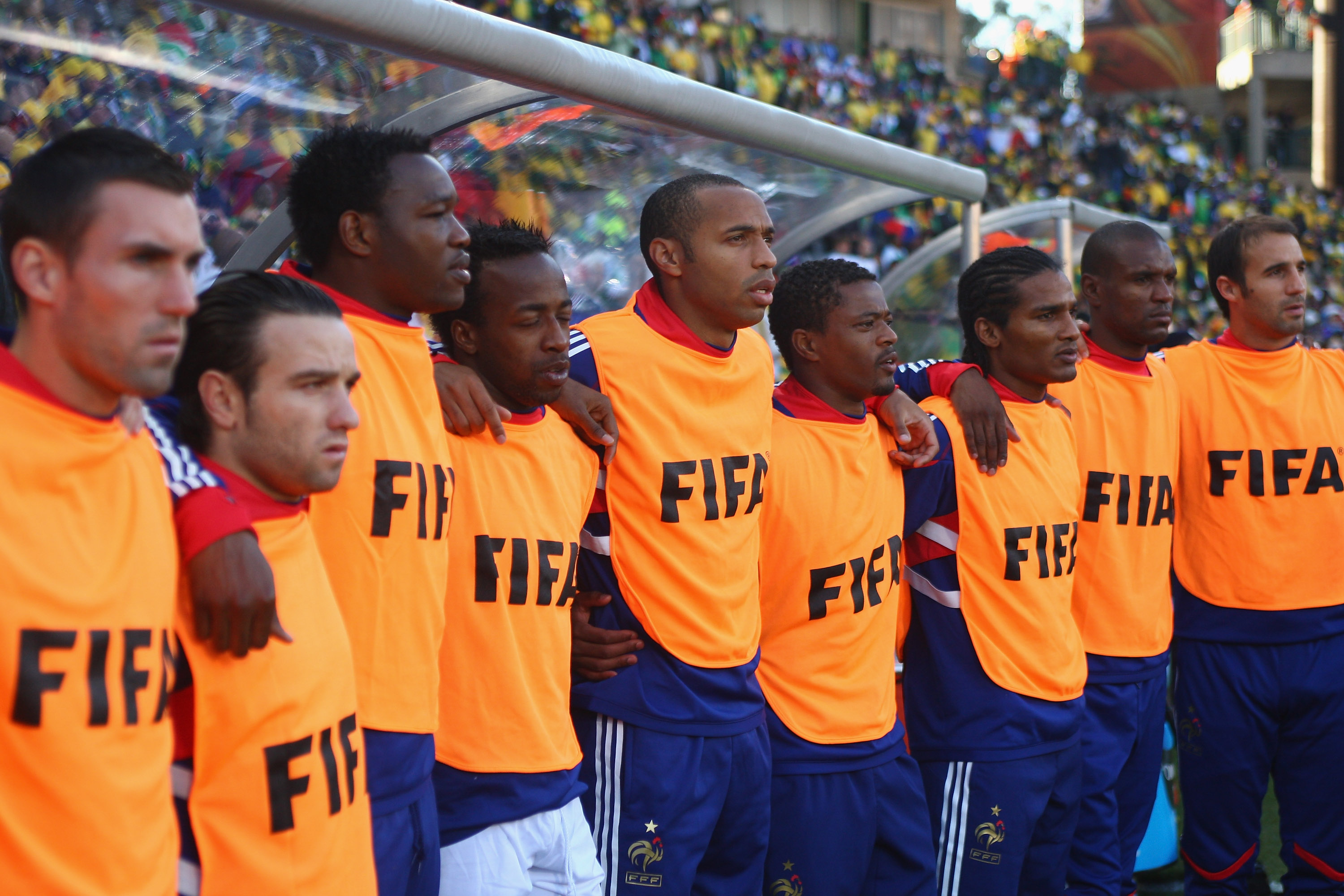 BLOEMFONTEIN, SOUTH AFRICA - JUNE 22:  Thierry Henry (c)of France  lines up during the national anthem alongside Sidney Govou (4th l), Patrice Evra (4th r) and Florent Malouda (3rd r) during the 2010 FIFA World Cup South Africa Group A match between Franc