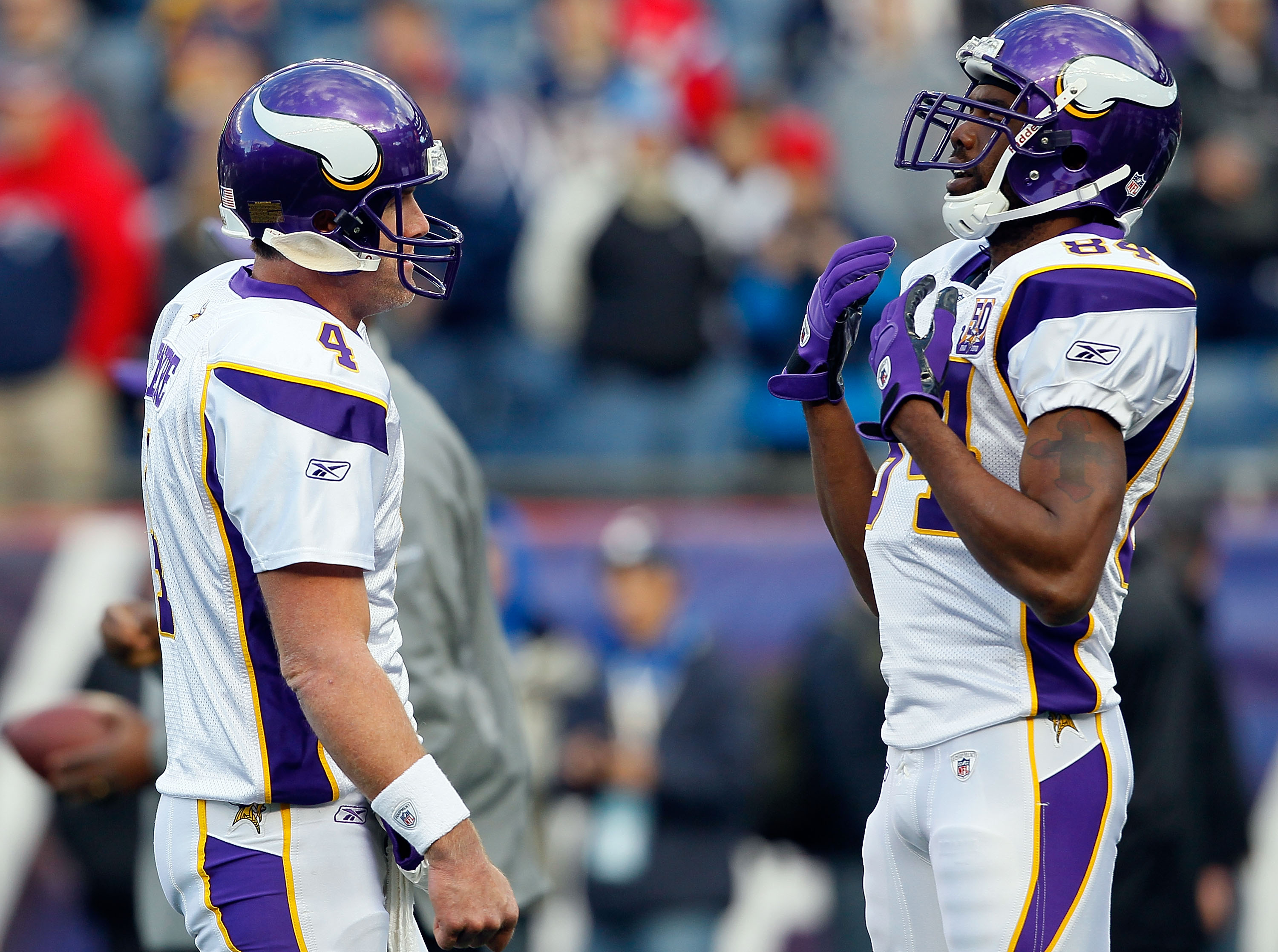 FOXBORO, MA - OCTOBER 31:  Brett Favre #4 of the Minnesota Vikings interacts with teammate Randy Moss #84 before a game against the New England Patriots at Gillette Stadium on October 31, 2010 in Foxboro, Massachusetts. (Photo by Jim Rogash/Getty Images)