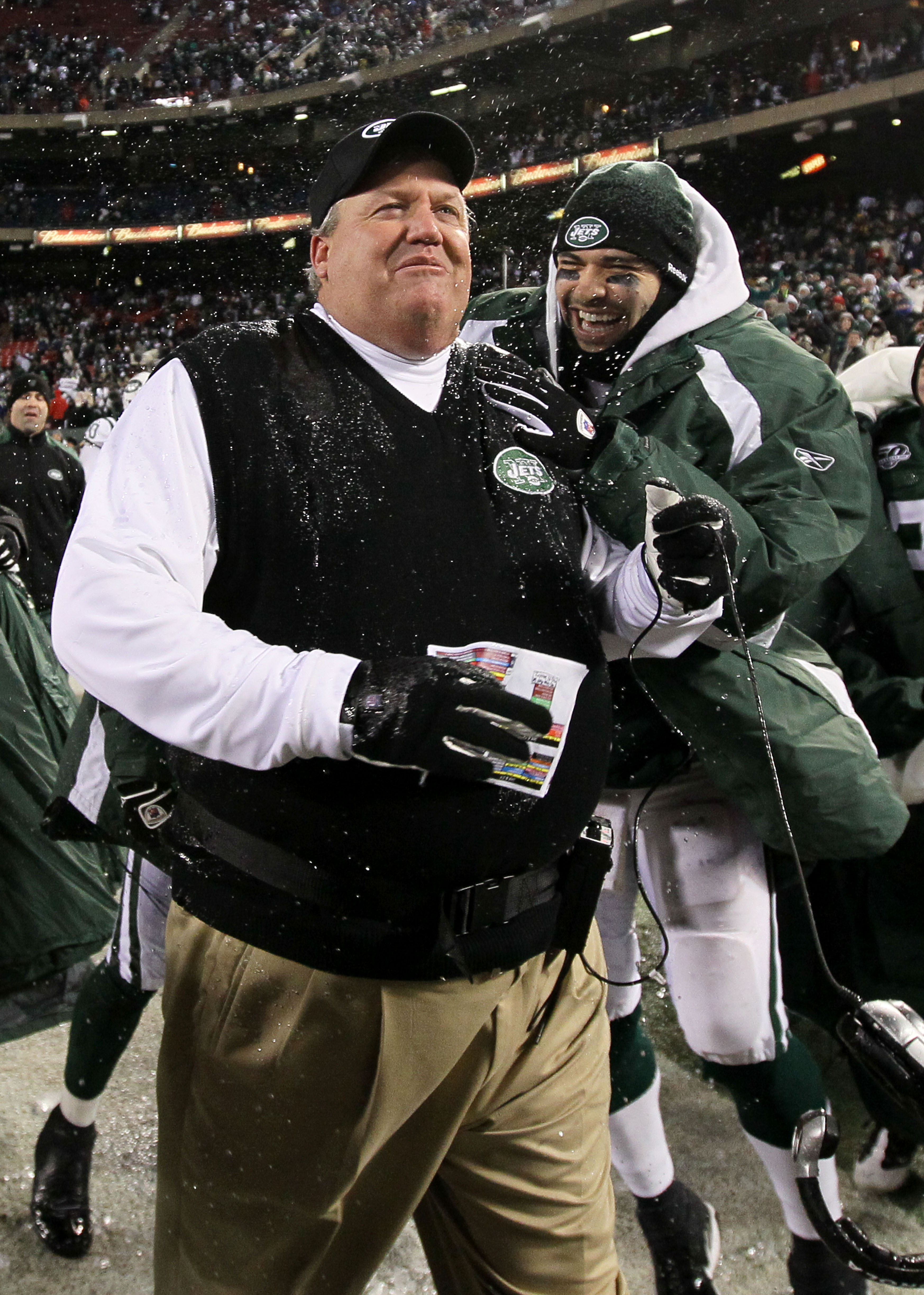 EAST RUTHERFORD, NJ - JANUARY 03:  Quarterback  Mark Sanchez #6 and head coach Rex Ryan  of the New York Jets celebrate their 37-0 victory over the Cincinnati Bengals at Giants Stadium on January 3, 2010 in East Rutherford, New Jersey.  This game was the