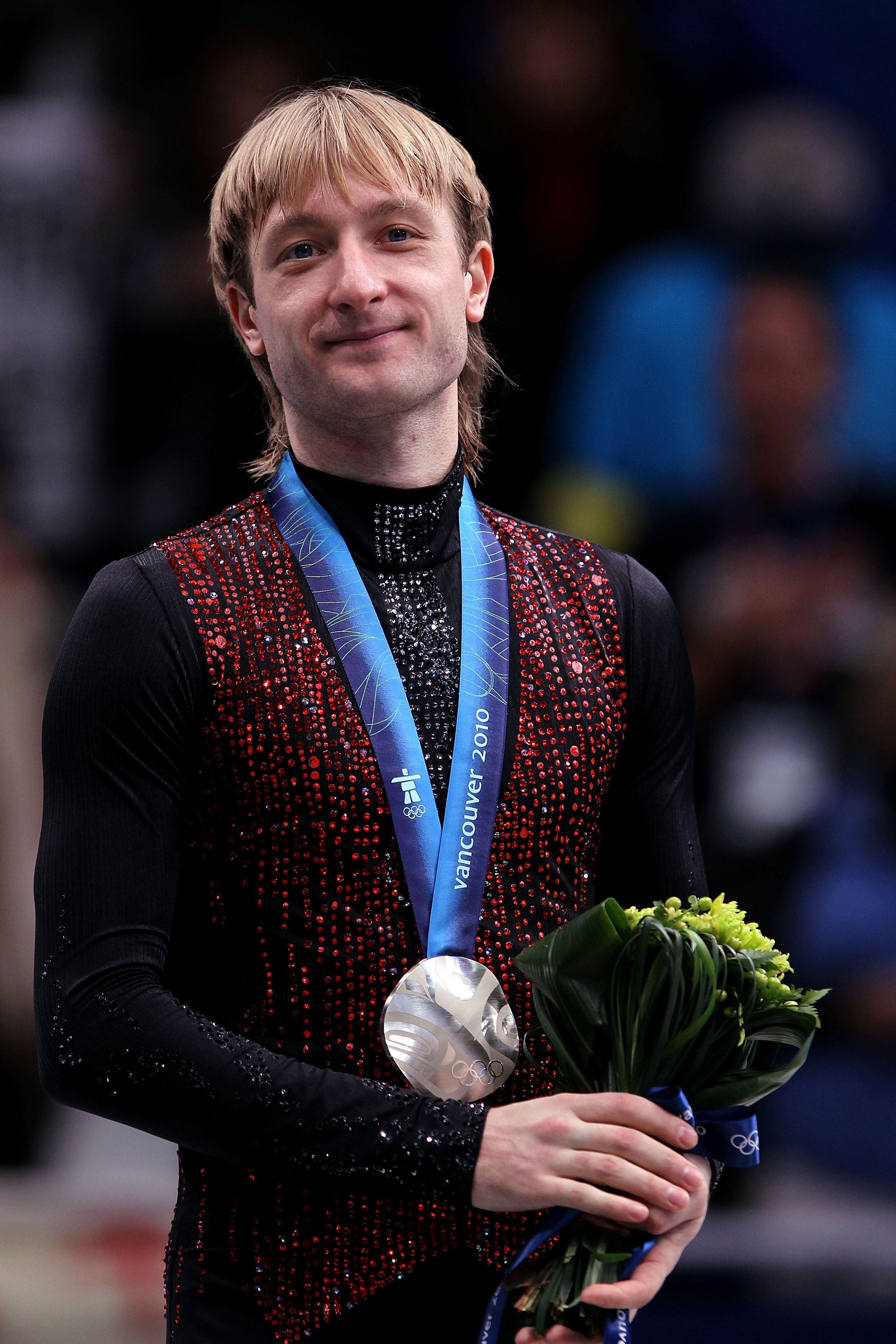 VANCOUVER, BC - FEBRUARY 18:  Silver medalist Evgeni Plushenko of Russia looks on in the men's figure skating free skating on day 7 of the Vancouver 2010 Winter Olympics at the Pacific Coliseum on February 18, 2010 in Vancouver, Canada.  (Photo by Matthew
