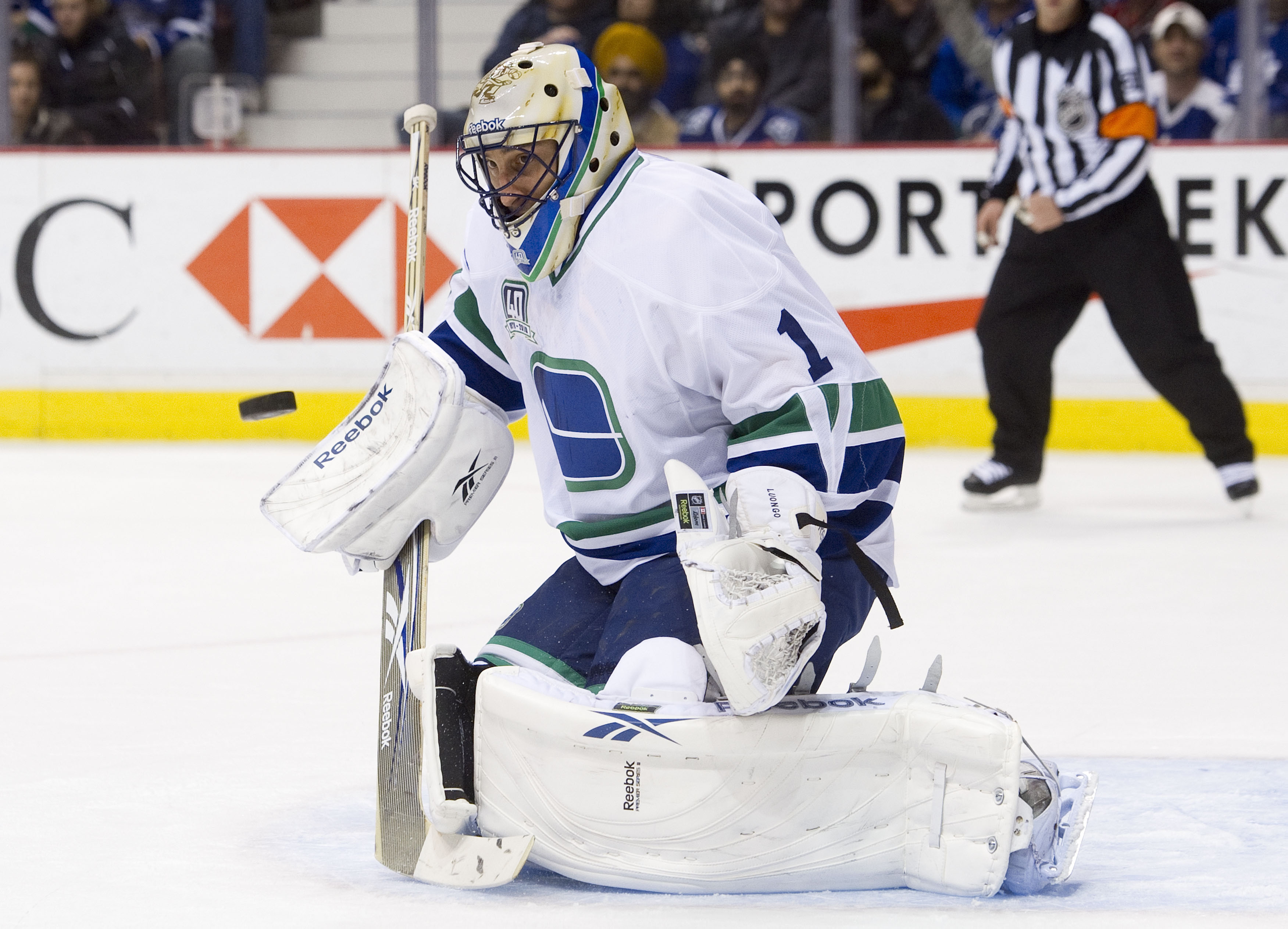 VANCOUVER, CANADA - DECEMBER 18: Goalie Roberto Luongo #1 of the Vancouver Canucks keeps an eye on the airborne puck after making a save against the Toronto Maple Leafs during the first period in NHL action on December 18, 2010 at Rogers Arena in Vancouve