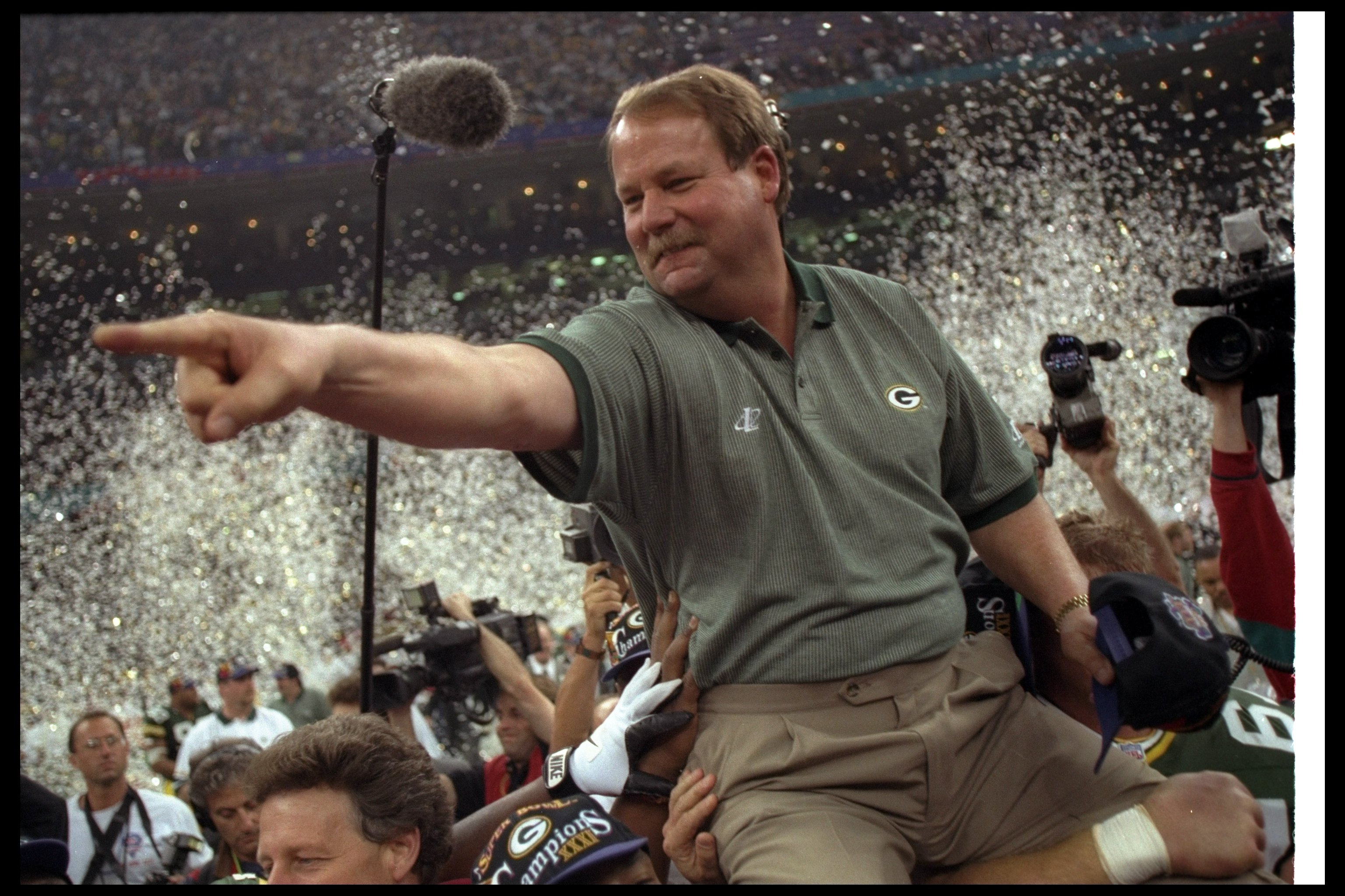 26 Jan 1997:  Green Bay Packers head coach Mike Holmgren celebrates after Super Bowl XXXI against the New England Patriots at the Superdome in New Orleans, Louisiana.  The Packers won the game, 35-21. Mandatory Credit: Rick Stewart  /Allsport
