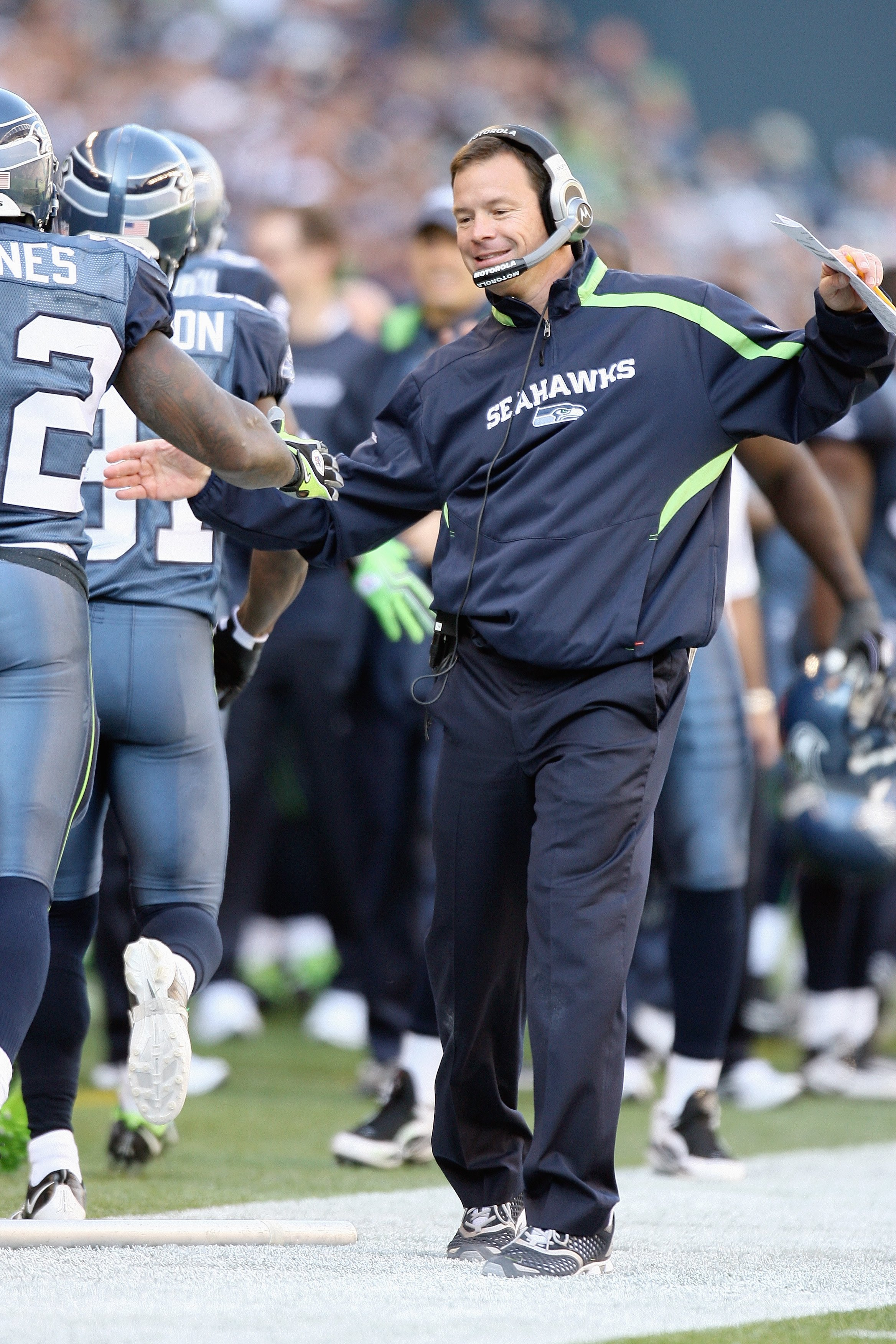 SEATTLE - OCTOBER 11: Head coach  Jim Mora of the Seattle Seahawks celebrates with his players during the game against the Jacksonville Jaguars on October 11, 2009 at Qwest Field in Seattle, Washington. The Seahawks defeated the Jaguars 41-0. (Photo by Ot