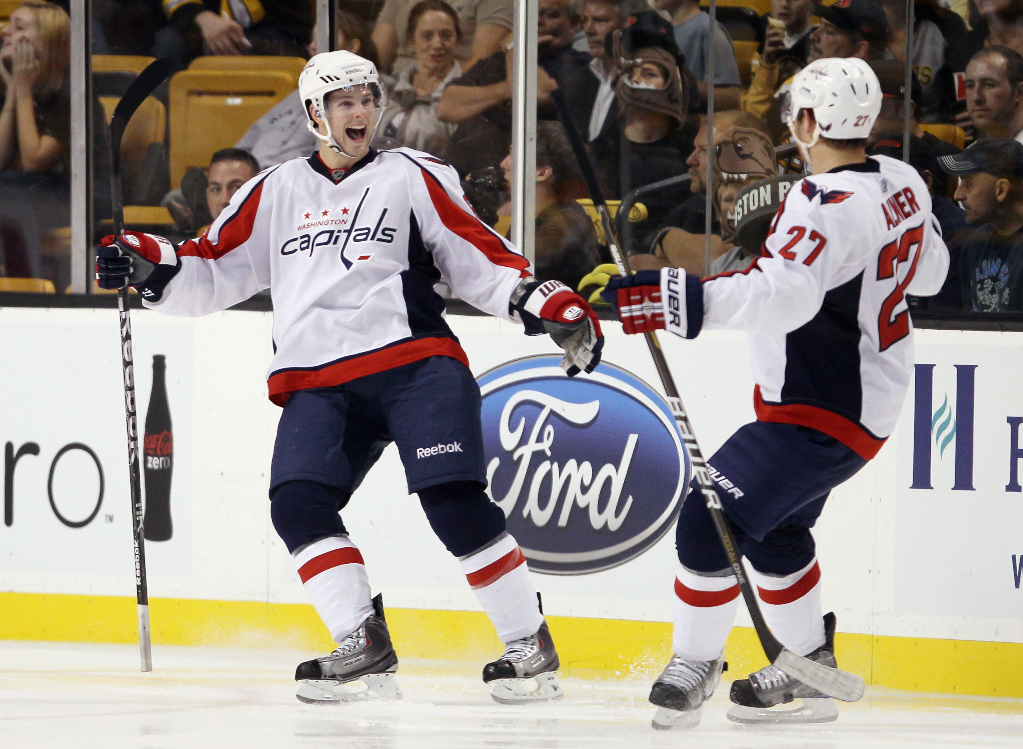 BOSTON - SEPTEMBER 29:  Andrew Gordon #63 and Karl Alzner #27 of the Washington Capitals celebrate a goal in the third period against the Boston Bruins on September 29, 2010 at the TD Garden in Boston, Massachusetts. The Capitals defeated the Bruins 4-1.