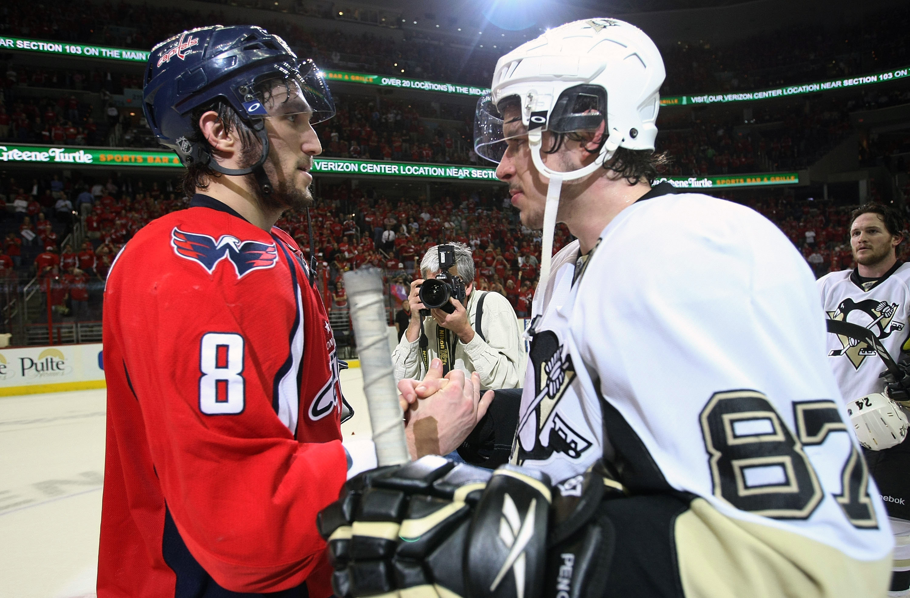 WASHINGTON - MAY 13: Alex Ovechkin #8 of the Washington Capitals and Sidney Crosby #87 of the Pittsburgh Penguins shake hands after Pittsburgh's 6-2 victory in Game Seven of the Eastern Conference Semifinal Round of the 2009 Stanley Cup Playoffs at Verizo