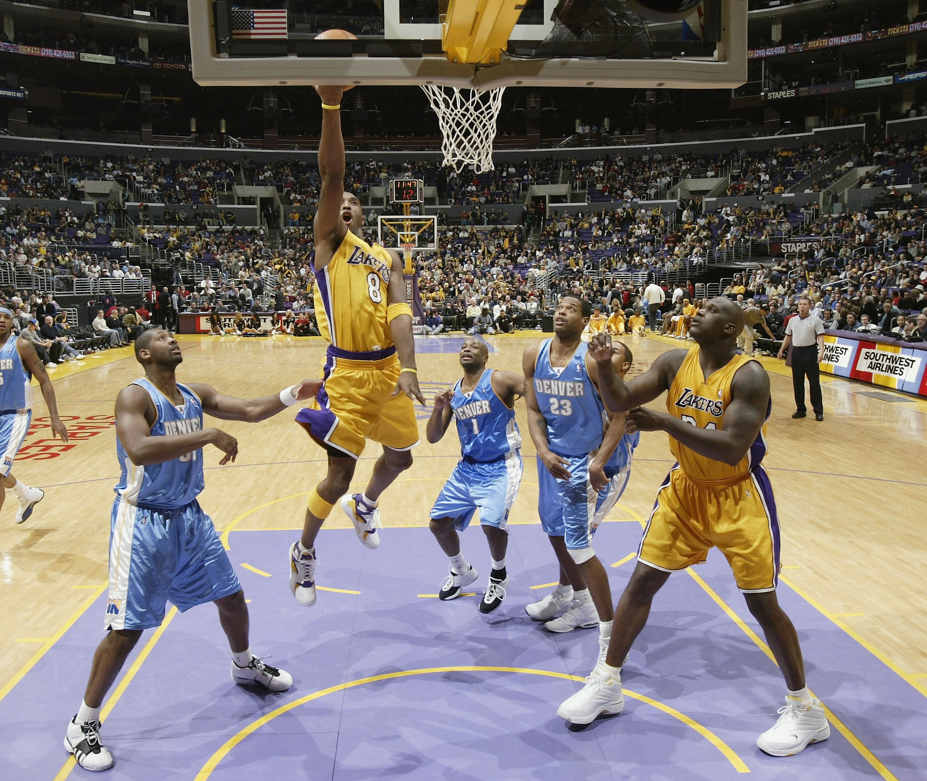 e0d0dc9440a LOS ANGELES - DECEMBER 19  Kobe Brayant  8 of the Los Angeles Lakers goes