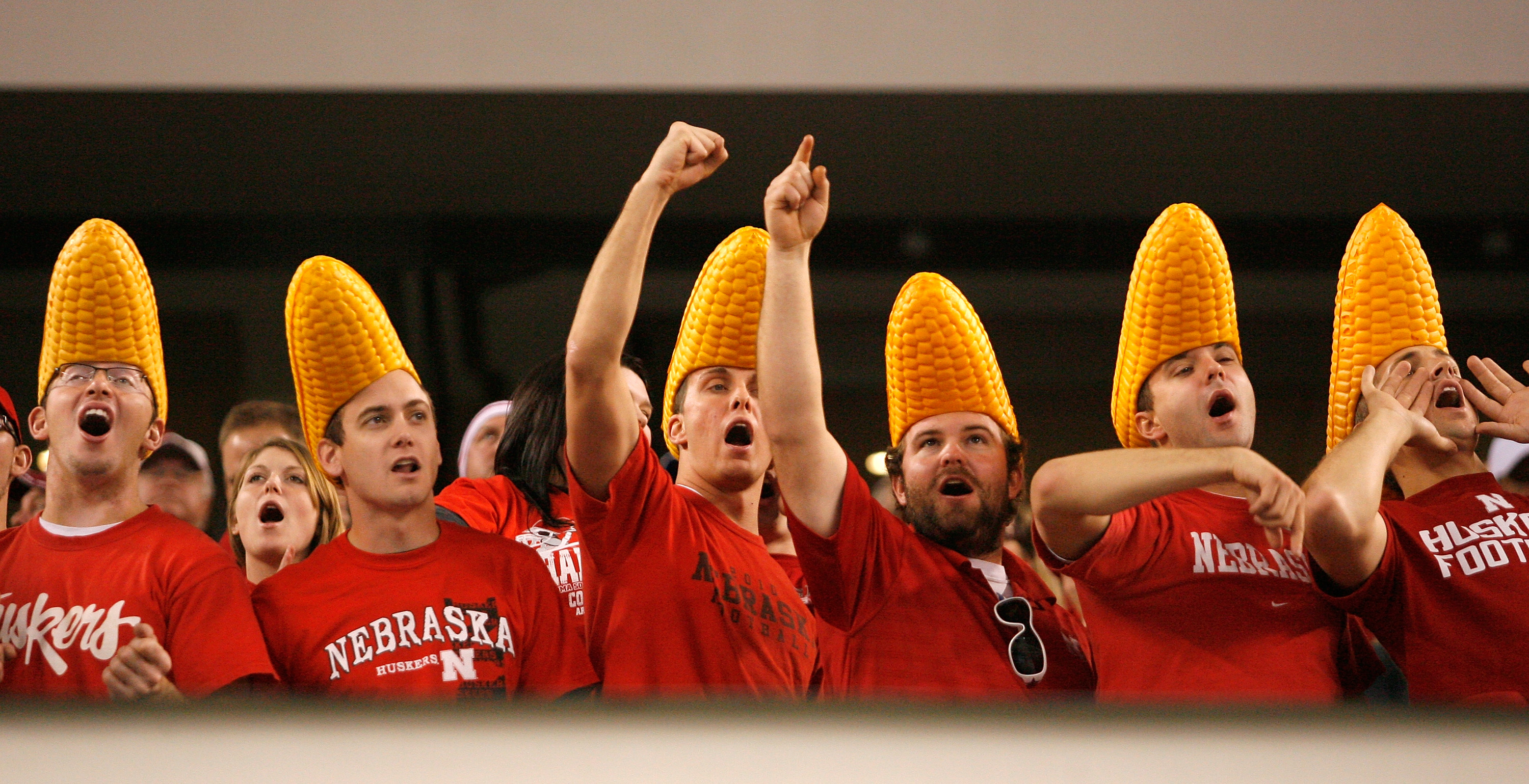 ARLINGTON, TX - DECEMBER 04:  Nebraska Cornhusker fans cheer on their team against the Oklahoma Sooners at Cowboys Stadium on December 4, 2010 in Arlington, Texas. The Sooners beat the Cornhuskers 23-20.  (Photo by Tom Pennington/Getty Images)