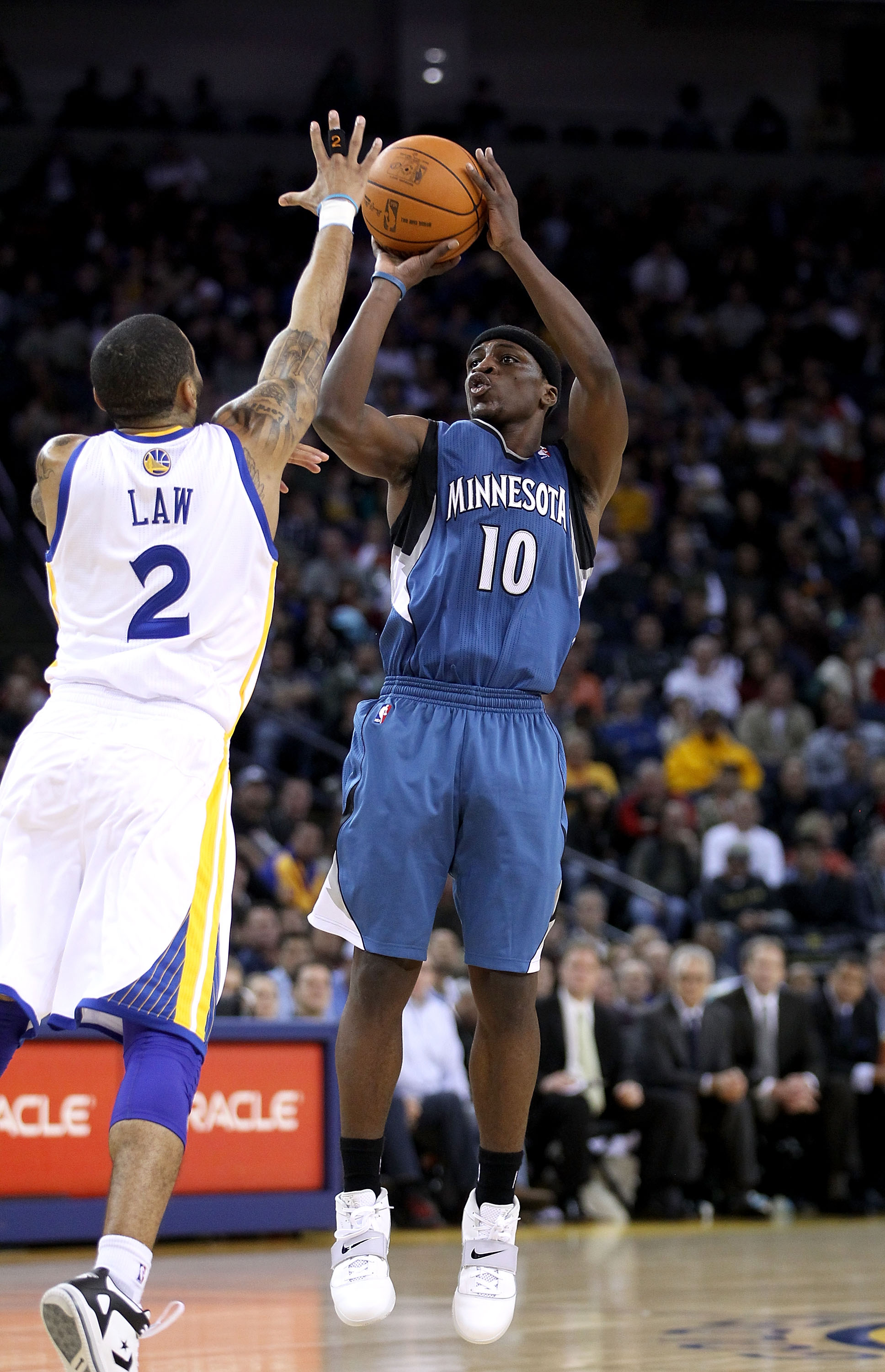 OAKLAND, CA - DECEMBER 14:  Jonny Flynn #10 of the Minnesota Timberwolves shoots over Acie Law #2 of the Golden State Warriors at Oracle Arena on December 14, 2010 in Oakland, California.  NOTE TO USER: User expressly acknowledges and agrees that, by down