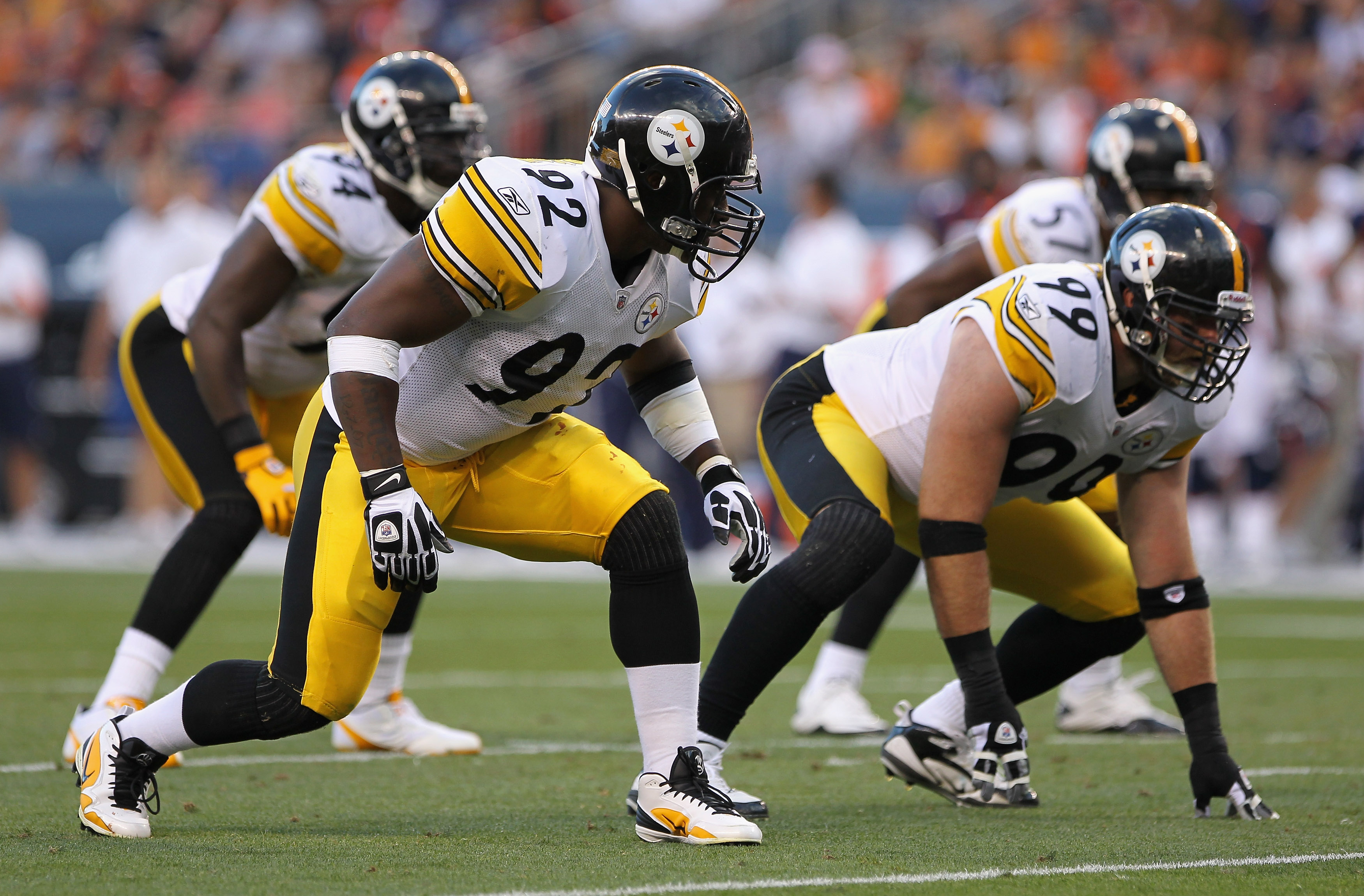 DENVER - AUGUST 29:  Linebacker James Harrison #92 and defensive end Brett Keisel #99 of the Pittsburgh Steelers lead the defense against the Denver Broncos during preseason NFL action at INVESCO Field at Mile High on August 29, 2010 in Denver, Colorado.