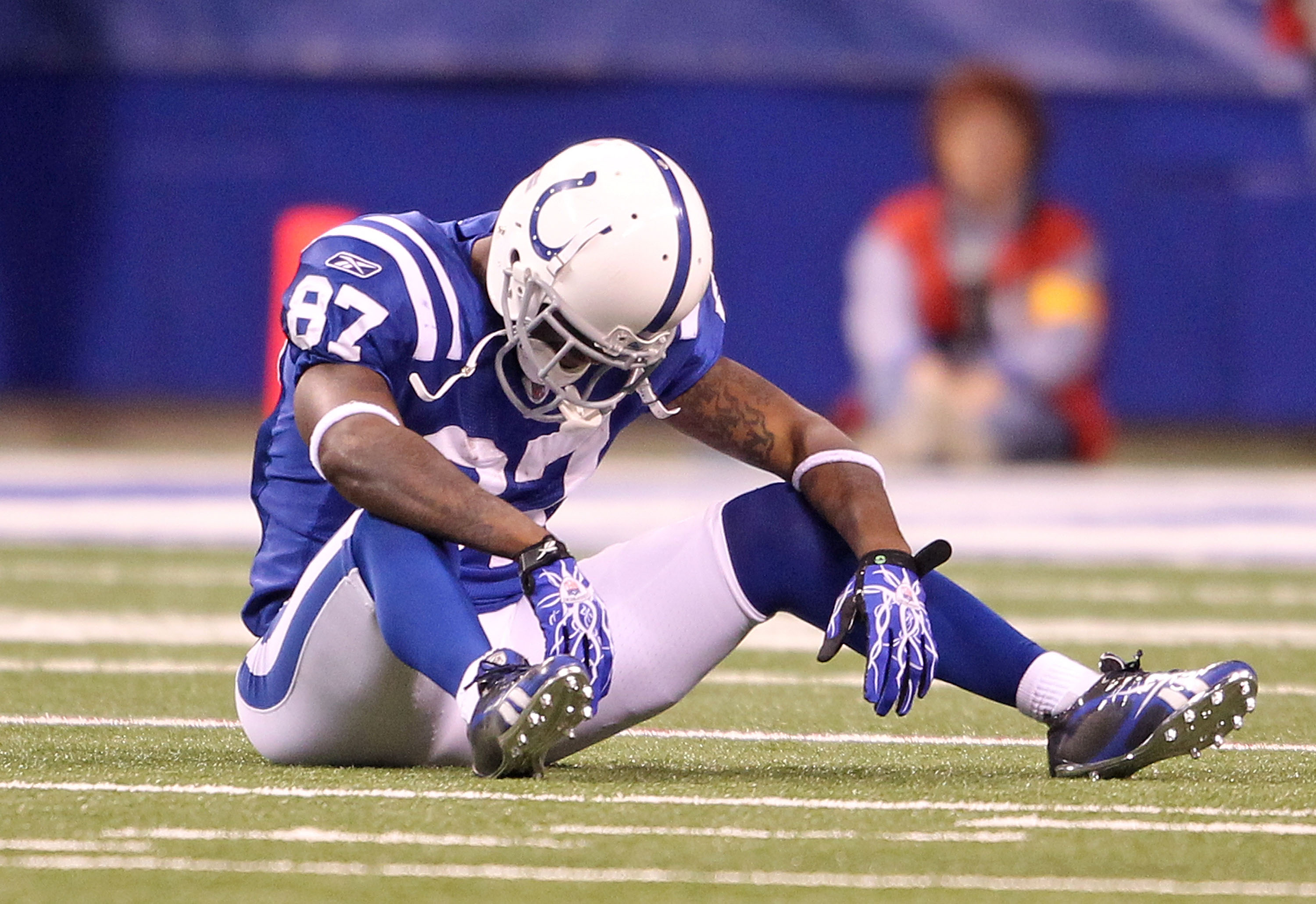 INDIANAPOLIS - NOVEMBER 28:  Reggie Wayne #87 of the Indianapolis Colts sits on the field after dropping a pass during the NFL game against the San Diego Chargers at Lucas Oil Stadium on November 28, 2010 in Indianapolis, Indiana. The chargers won 36-14.