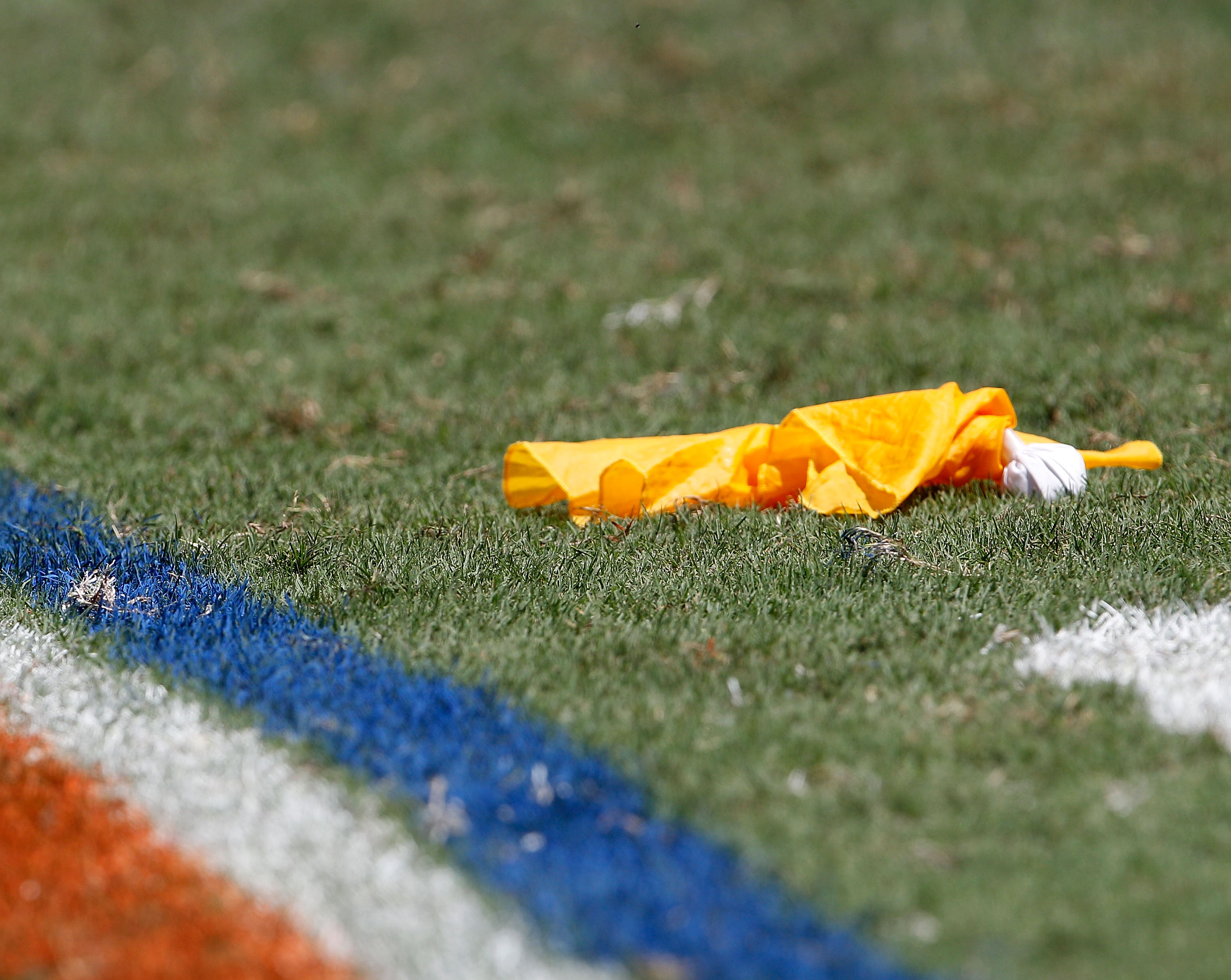 GAINESVILLE, FL - SEPTEMBER 11:  A penalty flag lies on the field during a game between the South Florida Bulls and the Florida Gators at Ben Hill Griffin Stadium on September 11, 2010 in Gainesville, Florida.  (Photo by Sam Greenwood/Getty Images)