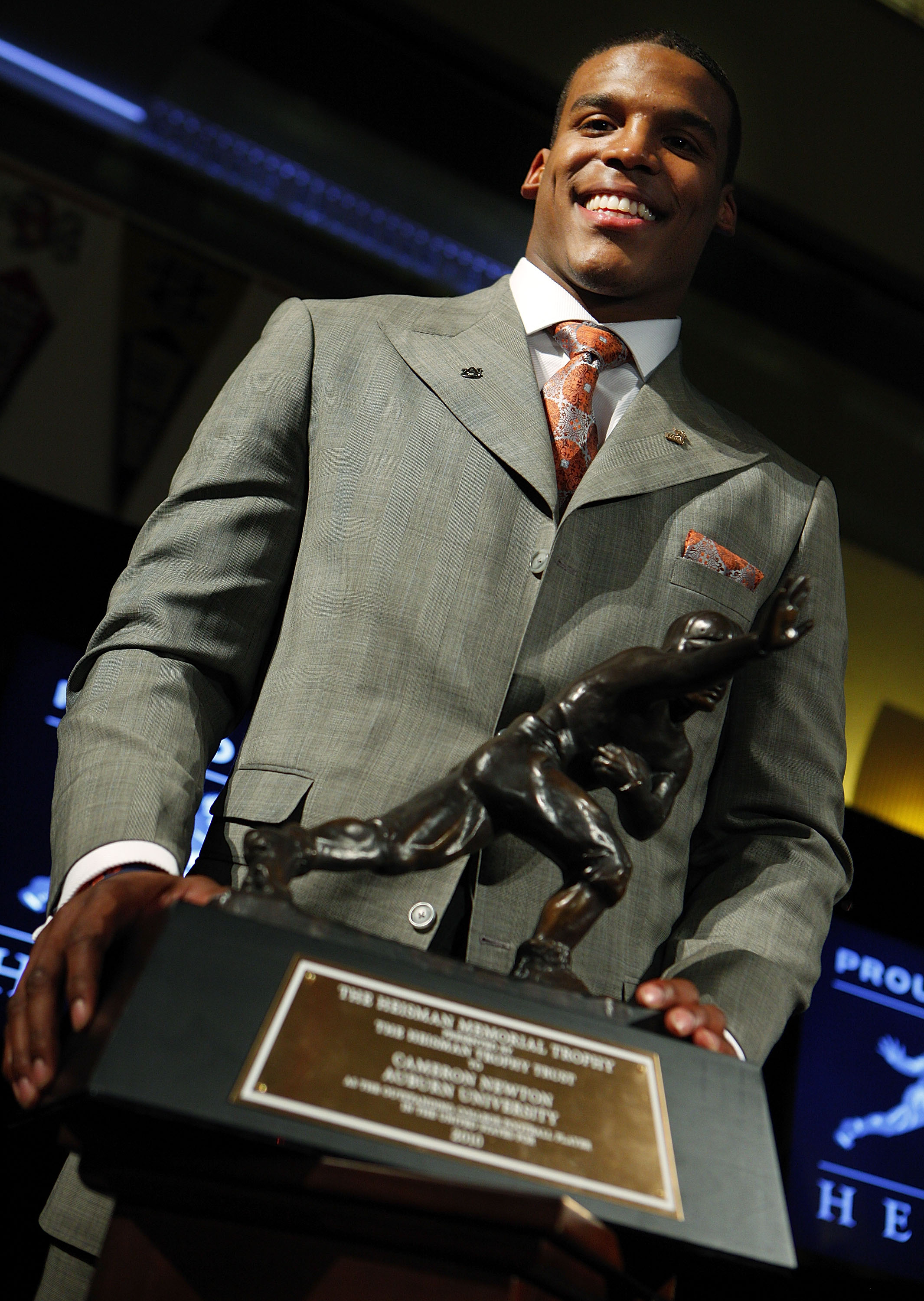 NEW YORK - DECEMBER 11:  Cam Newton, quarterback of the Auburn University Tigers, speaks after being awarded the 2010 Heisman Memorial Trophy Award on December 11, 2010 in New York City.  (Photo by Jeff Zelevansky/Getty Images)
