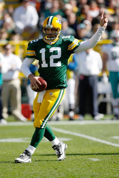 GREEN BAY, WI - OCTOBER 17: Aaron Rogers #12 of the Green Bay Packers points as he drops back to pass against the Miami Dolphins at Lambeau Field on October 17, 2010 in Green Bay, Wisconsin. (Photo by Scott Boehm/Getty Images)