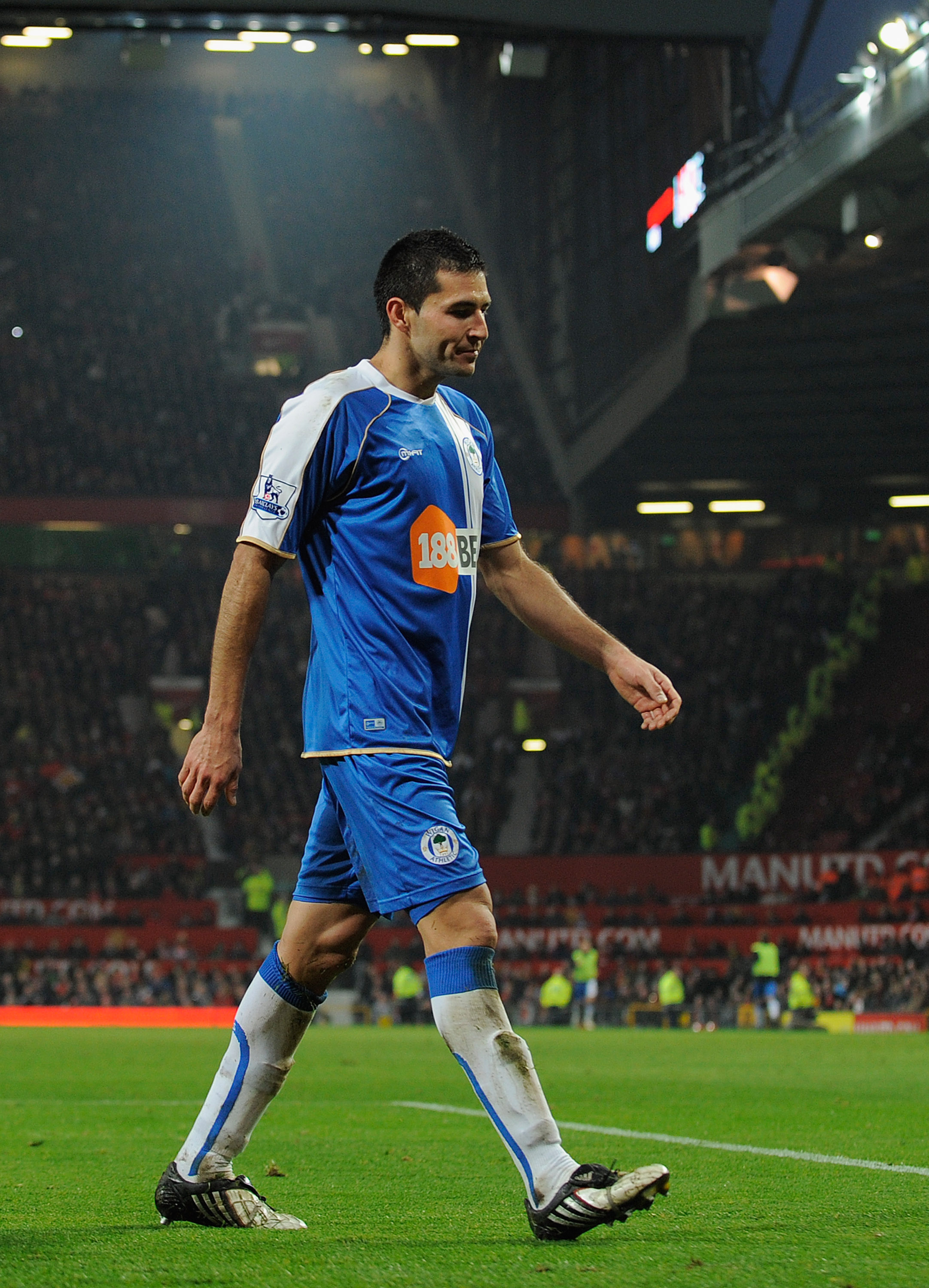 MANCHESTER, ENGLAND - NOVEMBER 20:  Antolin Alcaraz of Wigan walks of the pitch after getting a red card during the Barclays Premier League match between Manchester United and Wigan Athletic at Old Trafford on November 20, 2010 in Manchester, England.  (P