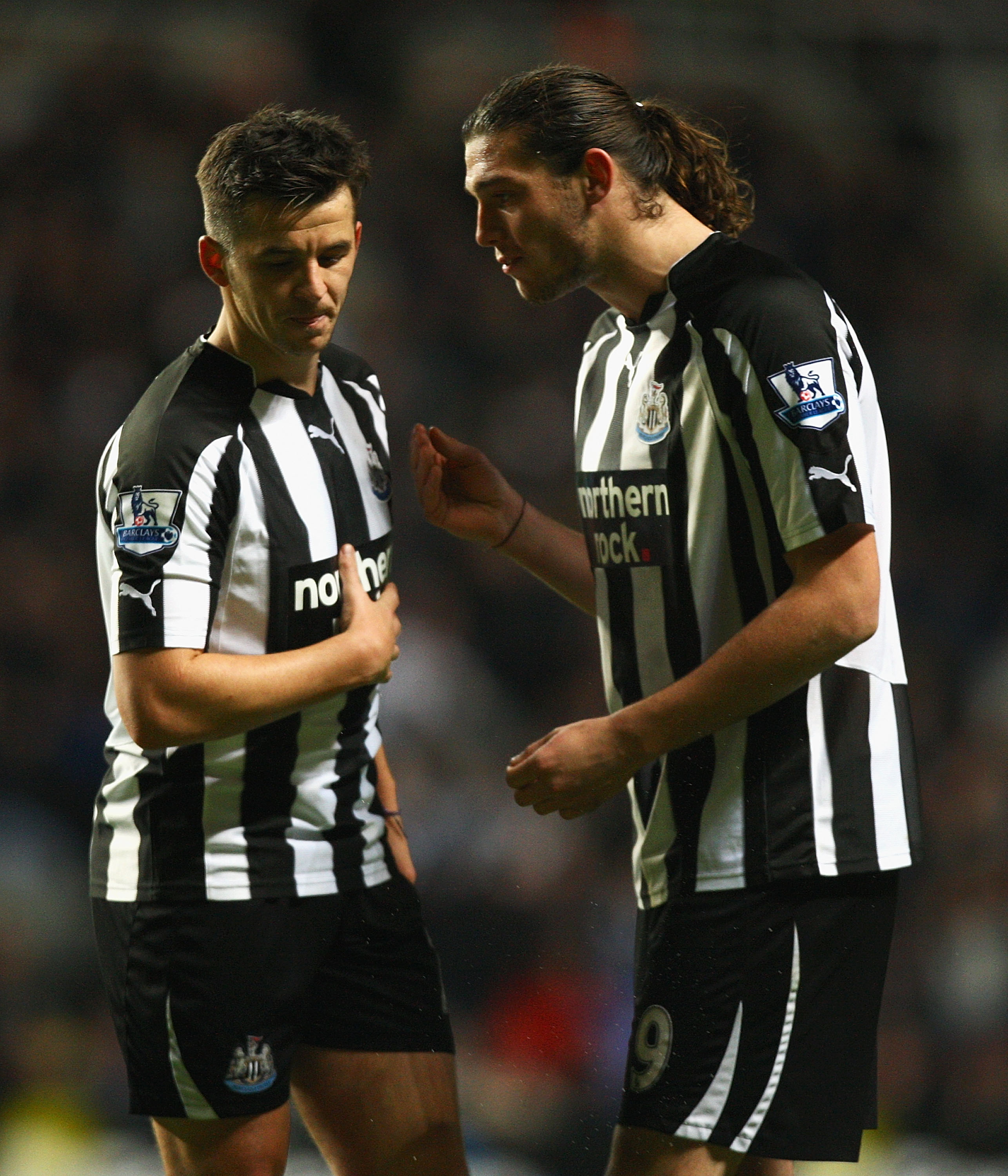 NEWCASTLE UPON TYNE, ENGLAND - NOVEMBER 10:  Joey Barton and Andy Caroll of Newcastle talk during the Barclays Premier League match between Newcastle United and Blackburn Rovers at St James' Park on November 10, 2010 in Newcastle upon Tyne, England.  (Pho