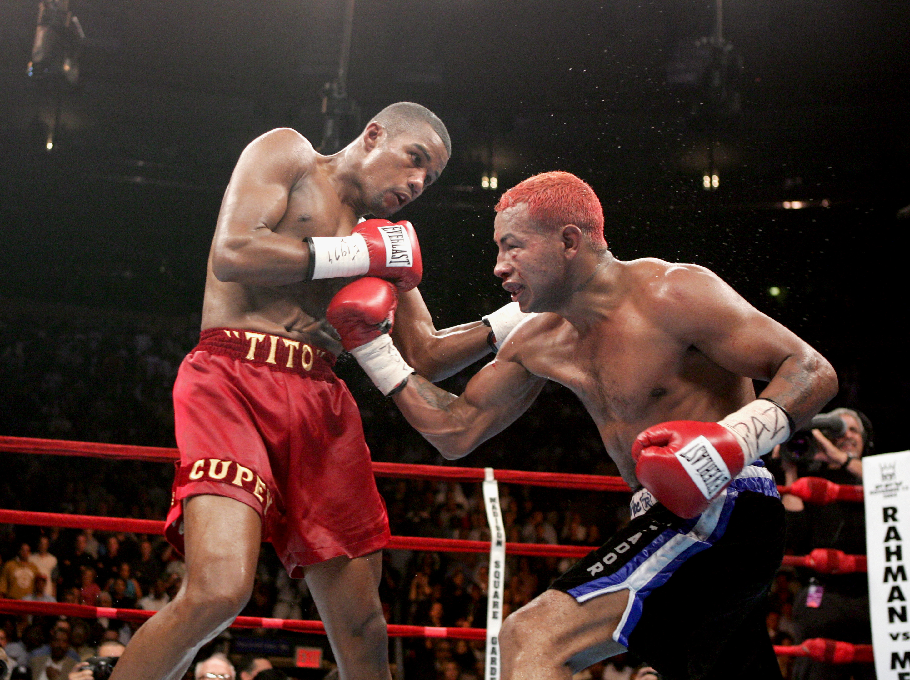 NEW YORK - OCTOBER 2:  Felix 'Tito' Trinidad Jr. (red shorts) fights with Ricardo Mayorga (black shorts) during a bout for the WBA North American and North American Boxing Council middleweight titles at Madison Square Garden on October 2, 2004 in New York